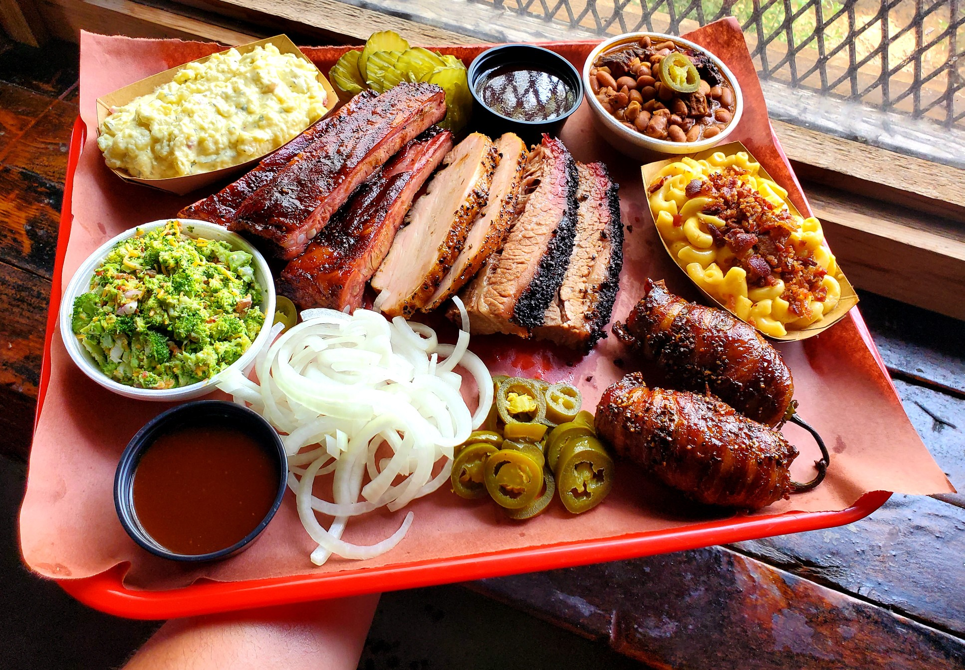 A red platter of barbecue