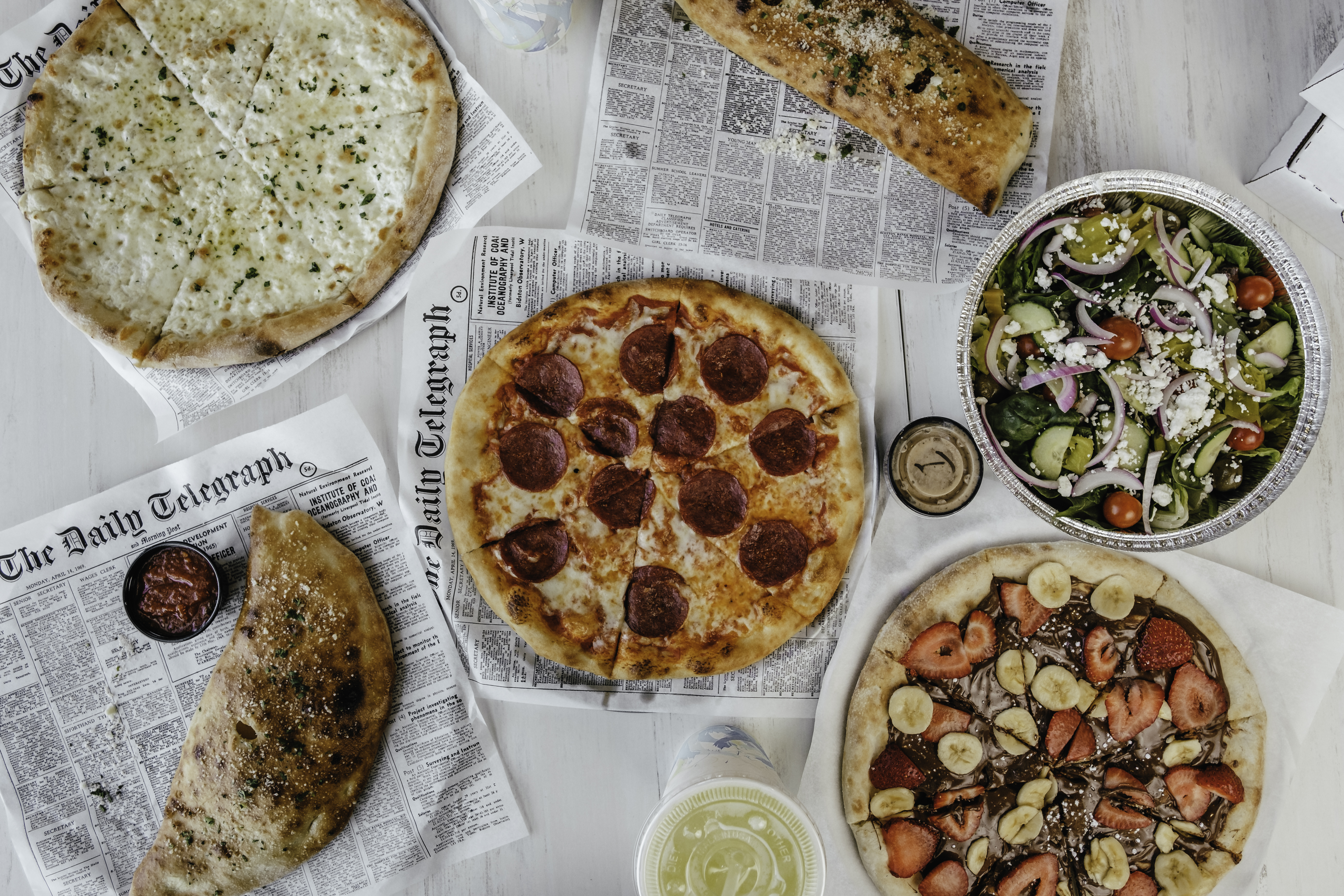 Pepperoni pizza, calzone, stromboli, Nutella pizza, salad, and Napolitana.