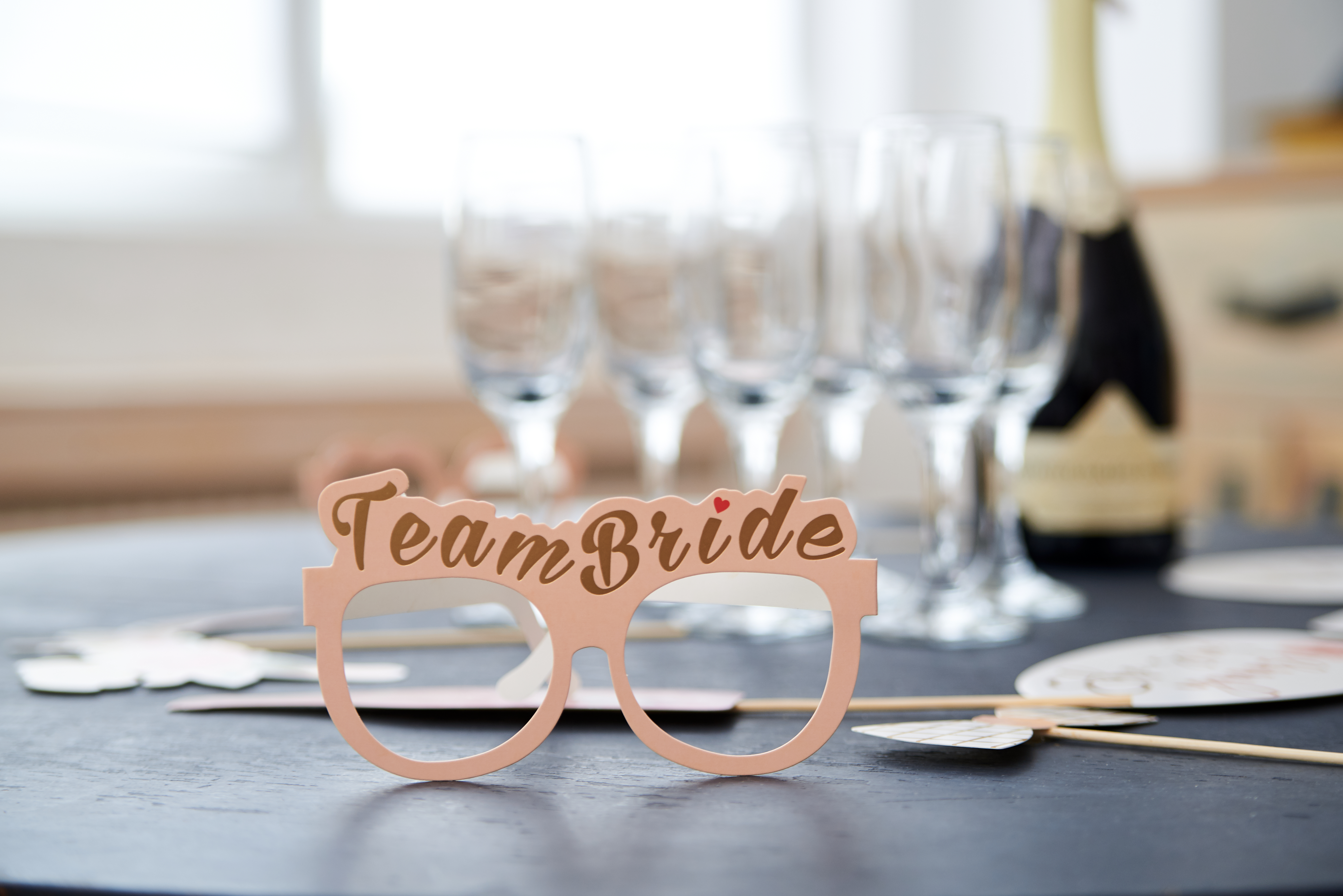 A party spread with pink sunglasses.
