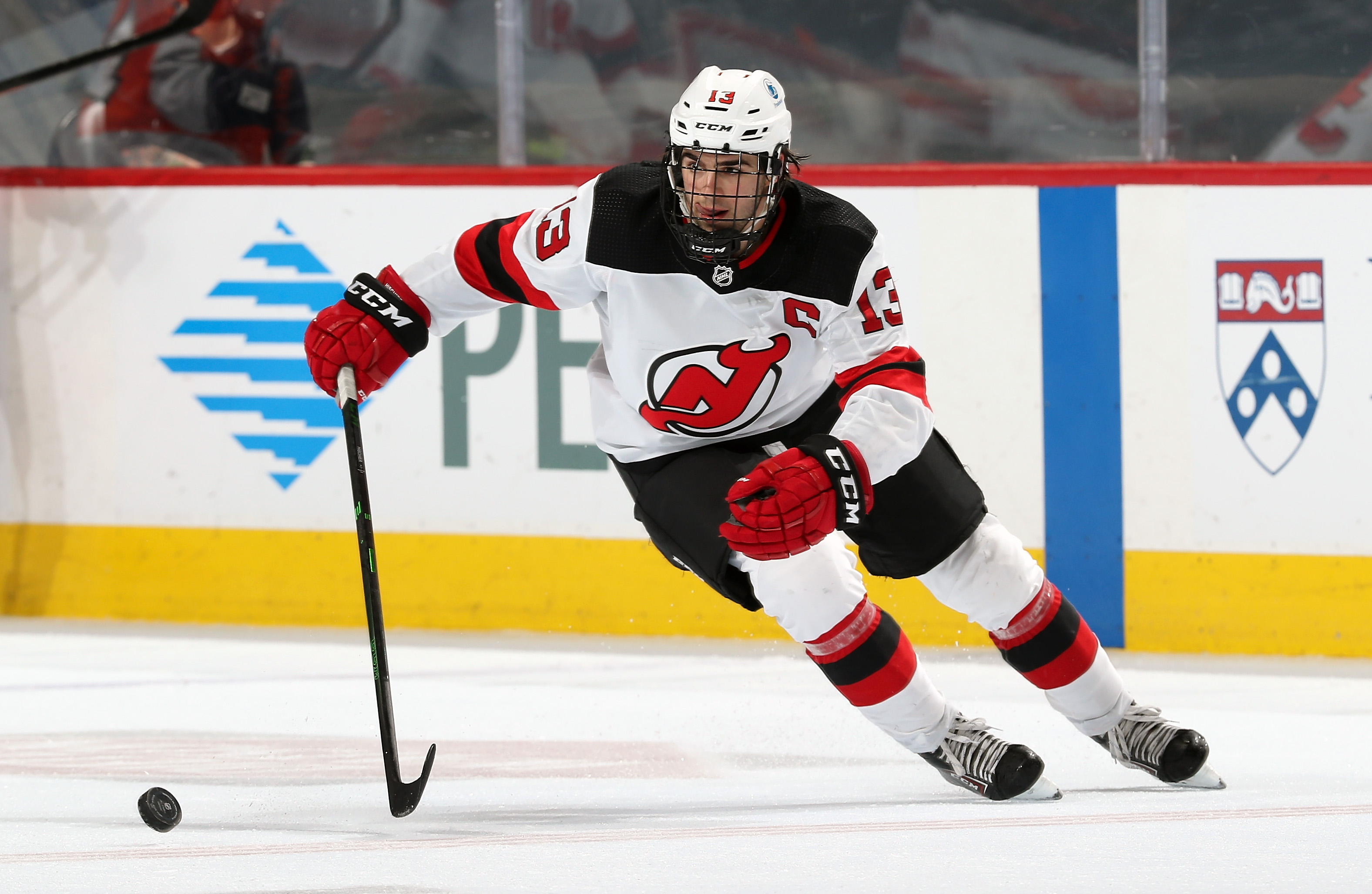 Nico Hischier #13 of the New Jersey Devils skates the puck against the Philadelphia Flyers at the Wells Fargo Center on May 10, 2021 in Philadelphia, Pennsylvania.