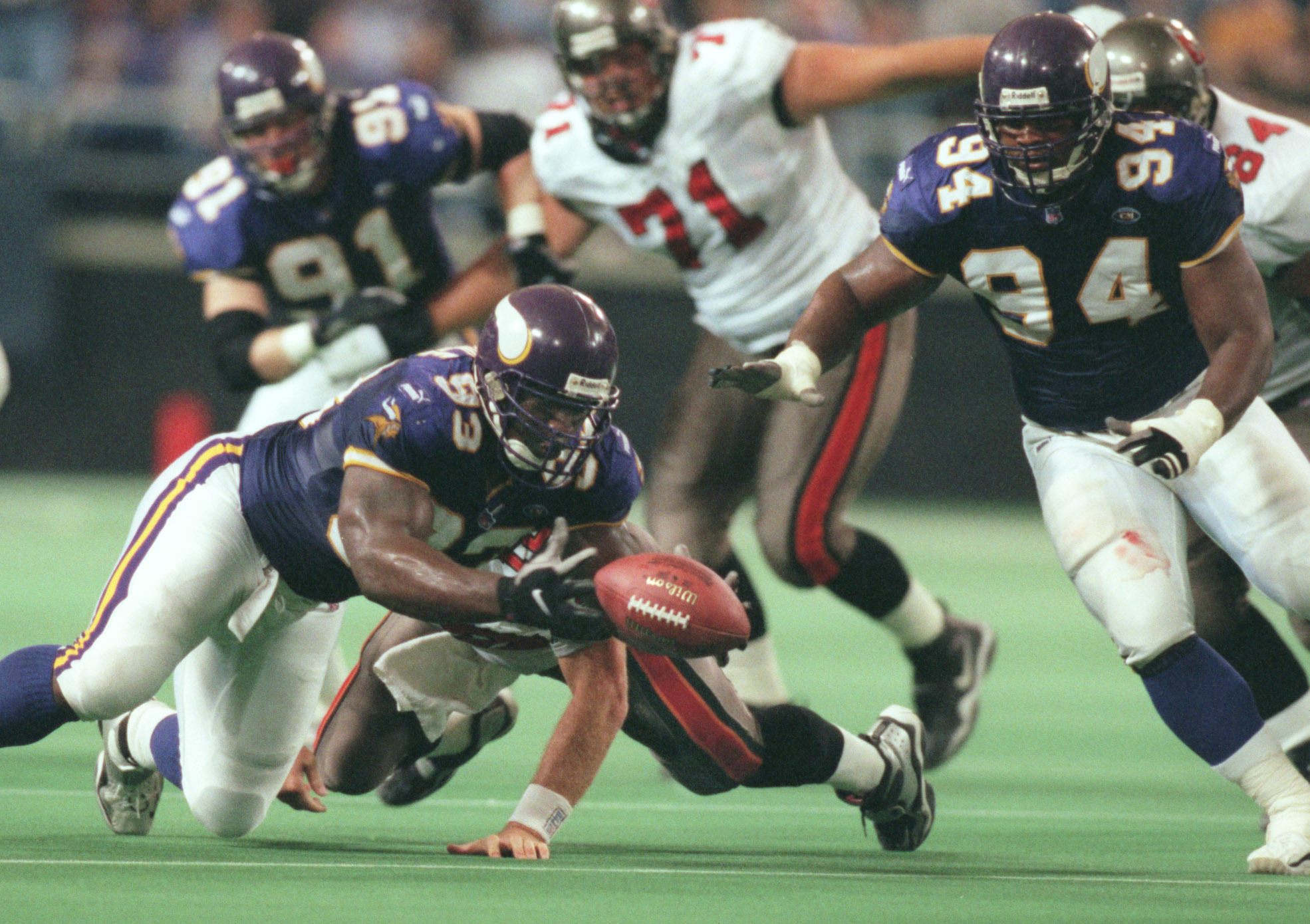 Oct. 3-Tampa Bay - Minnesota Vikings — Minneapolis Mn, Sunday 10/3/99 Vikings vs Tampa----Vikings John Randle scopes up a Trent Dilfer fumble that he caused early in the 4h quarter as his teamate Tony Williams looks on.