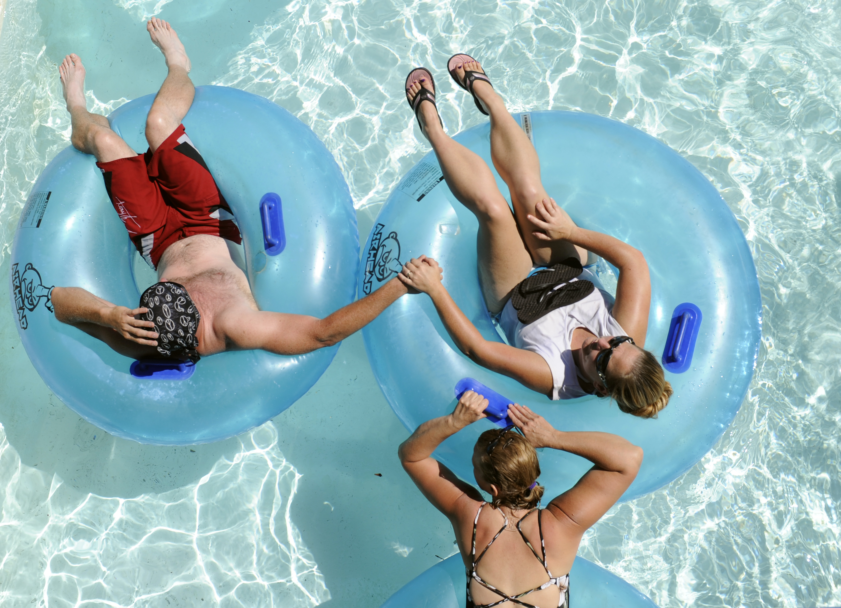 """A quiet ride for three on """"The Lazy River"""". Labor Day is the final day of the 2011 season for Water World in Thornton. Thousands took advantage of the sunny weather in the park for the final splash of the summer. Joann Cortez, spokesperson for the park, s"""