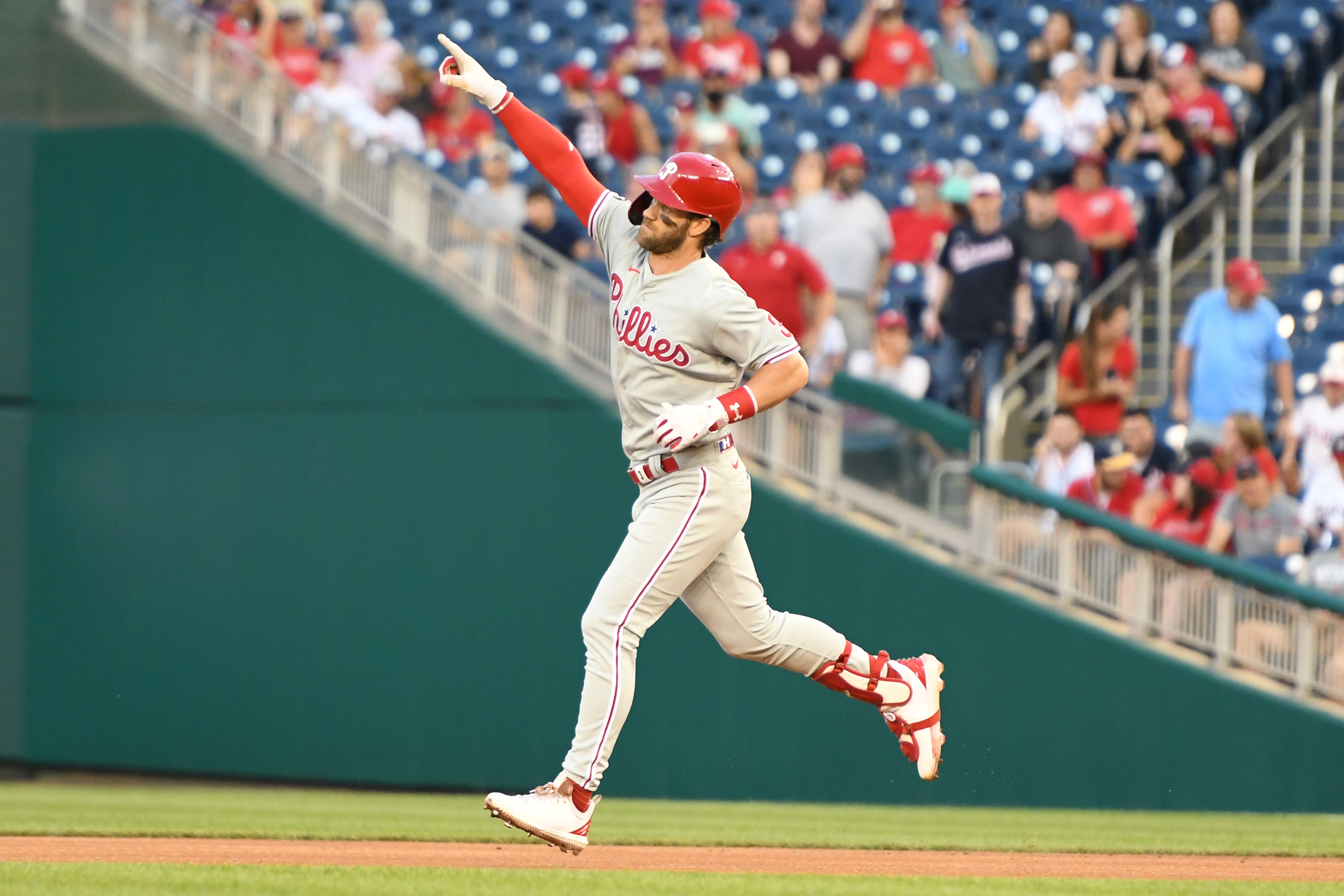 Bryce Harper #3 of the Philadelphia Phillies celebrates a two run home run in the first inning during a baseball game against the Washington Nationals at Nationals Park on August 30, 2021 in Washington, DC