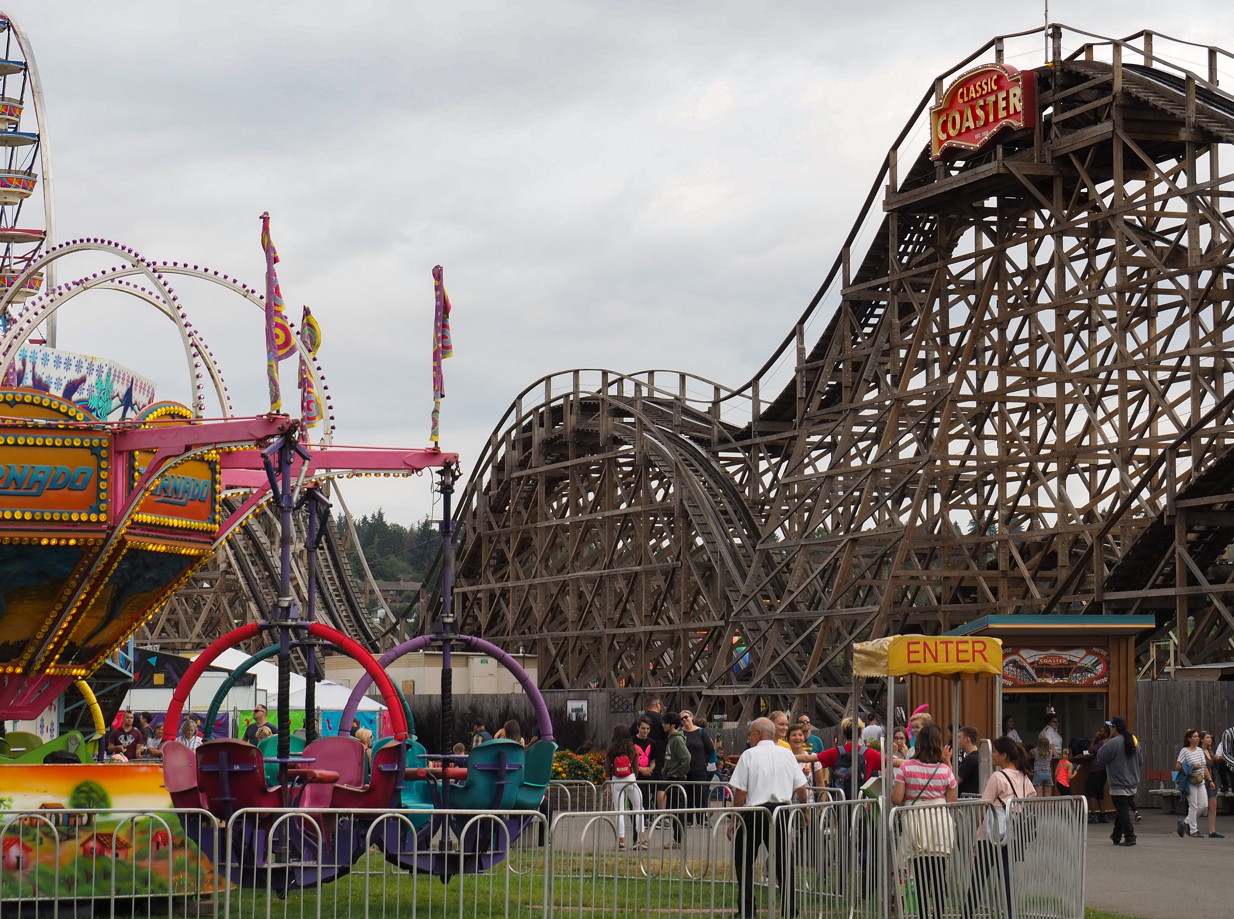 A roller coaster on a cloudy day at the Washington State Fair in Puyallup.