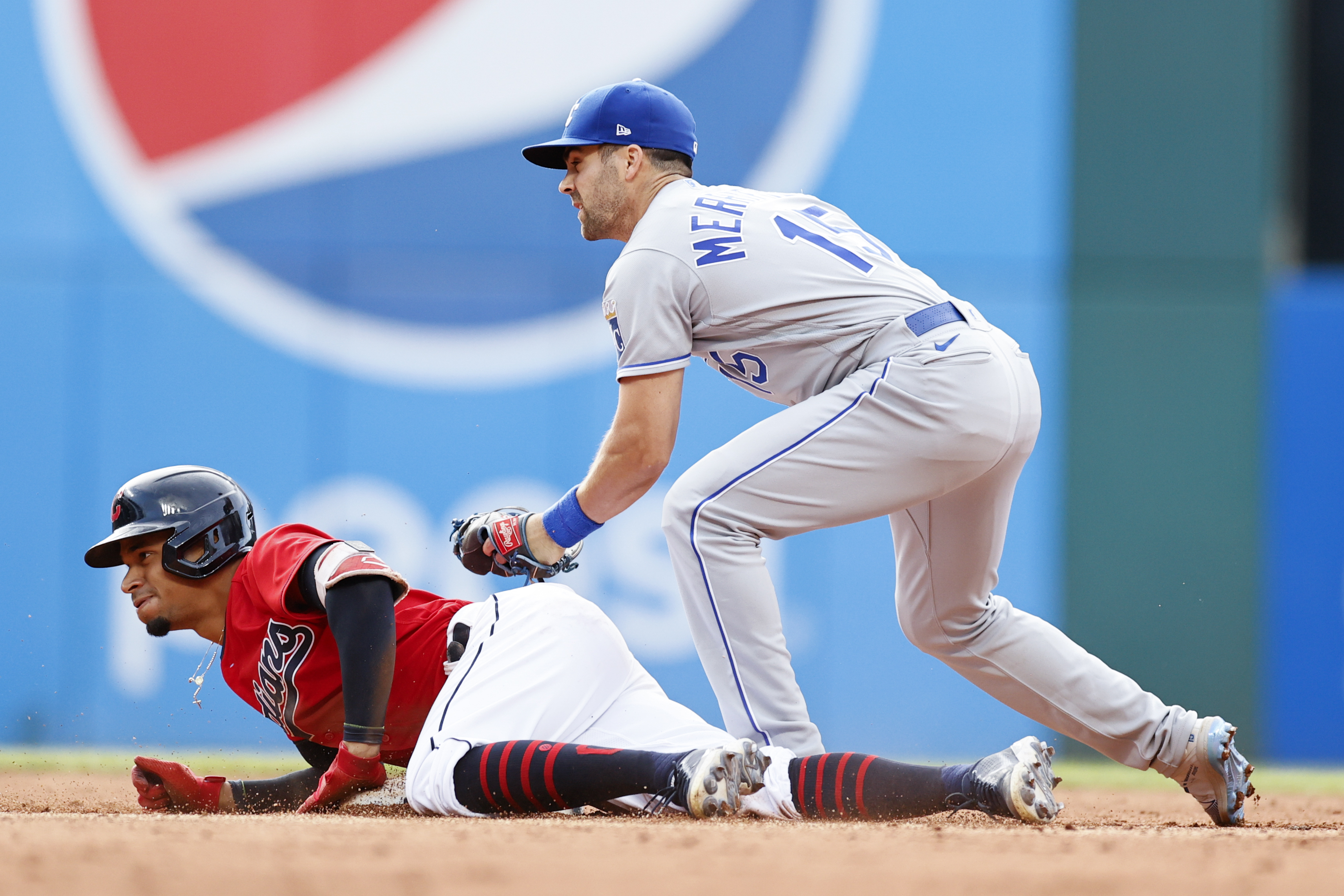Oscar Mercado #35 of the Cleveland Indians is safe at second base after hitting an RBI single and advancing on an error as Whit Merrifield #15 of the Kansas City Royals covers during the fourth inning at Progressive Field on July 10, 2021 in Cleveland, Ohio.