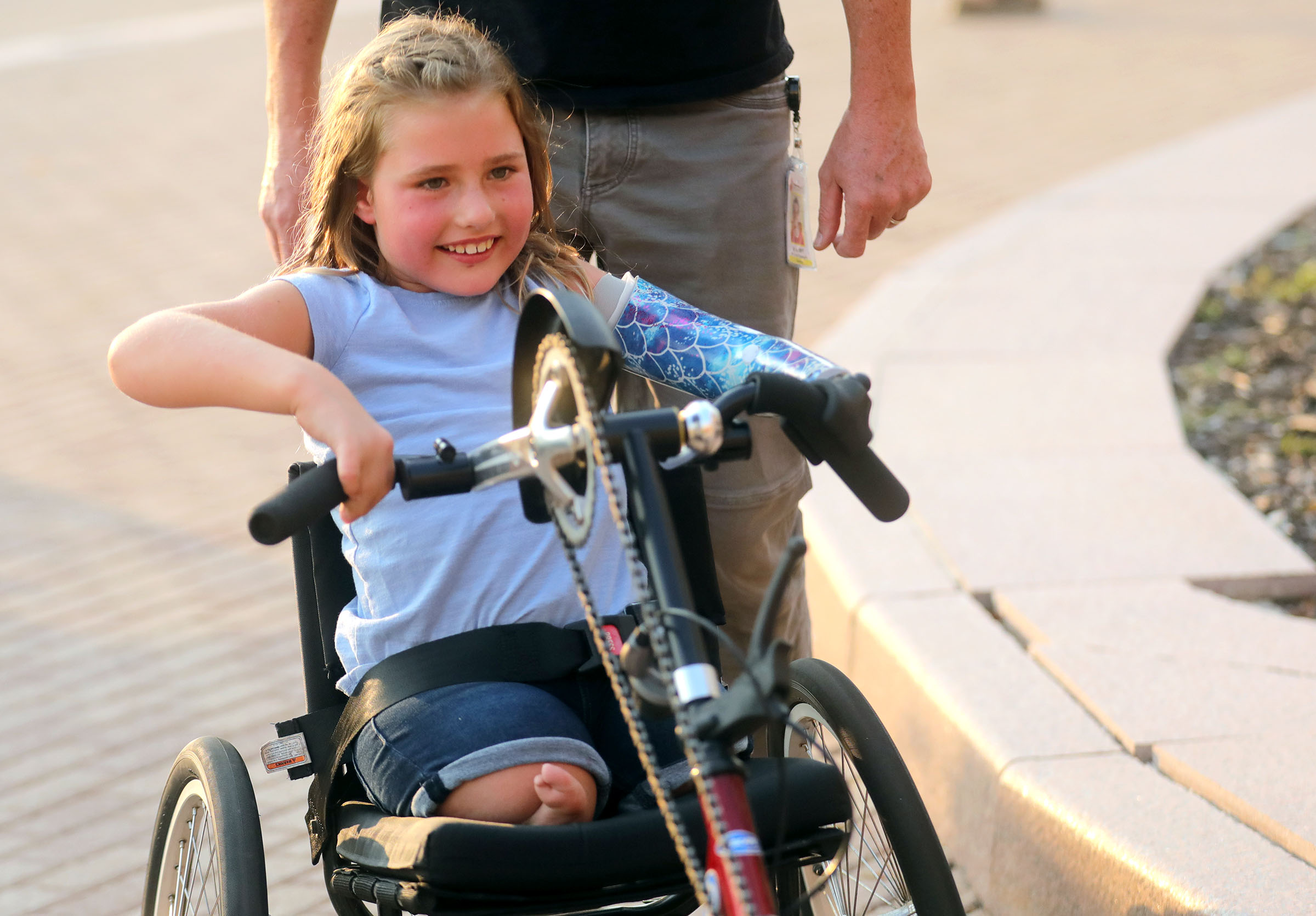 Jackie Woodward rides her adaptive bike outside of Shriners Hospitals for Children in Salt Lake City on Monday.