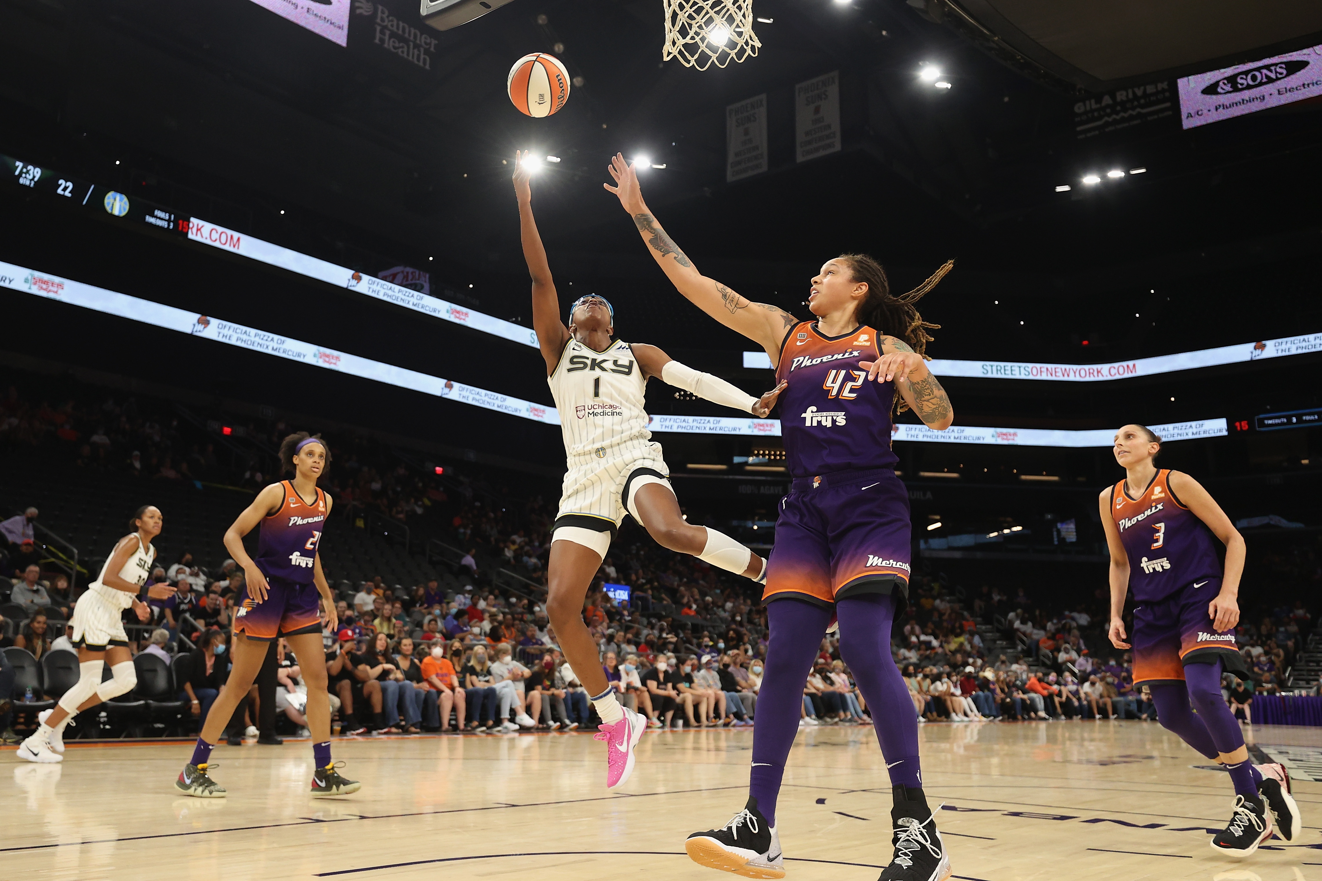 The Sky's Diamond DeShields makes a layup in front of the Mercury's Brittney Griner Tuesday night.