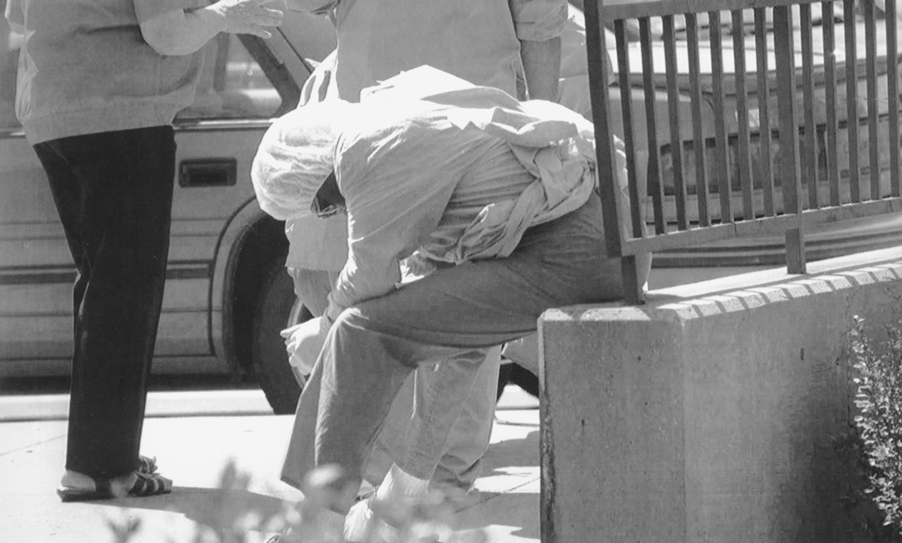 A worker rests after bringing bodies into the Cook County Medical Examiner's Office during the 1995 Chicago heat wave.