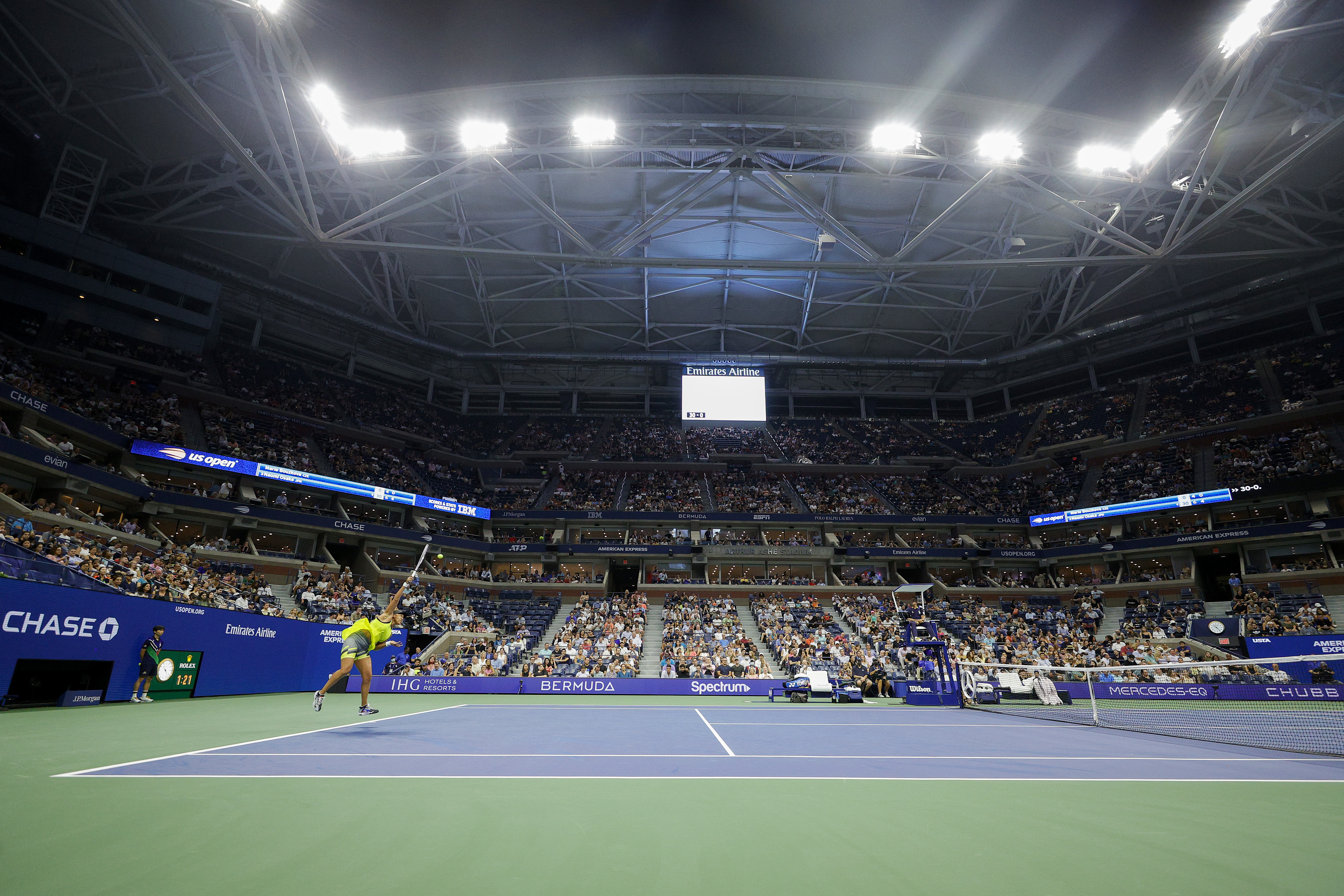 Naomi Osaka of Japan serves against Marie Bouzkova of Czech Republic during their women's singles first round match on Day One of the 2021 US Open at the Billie Jean King National Tennis Center on August 30, 2021 in the Flushing neighborhood of the Queens borough of New York City.
