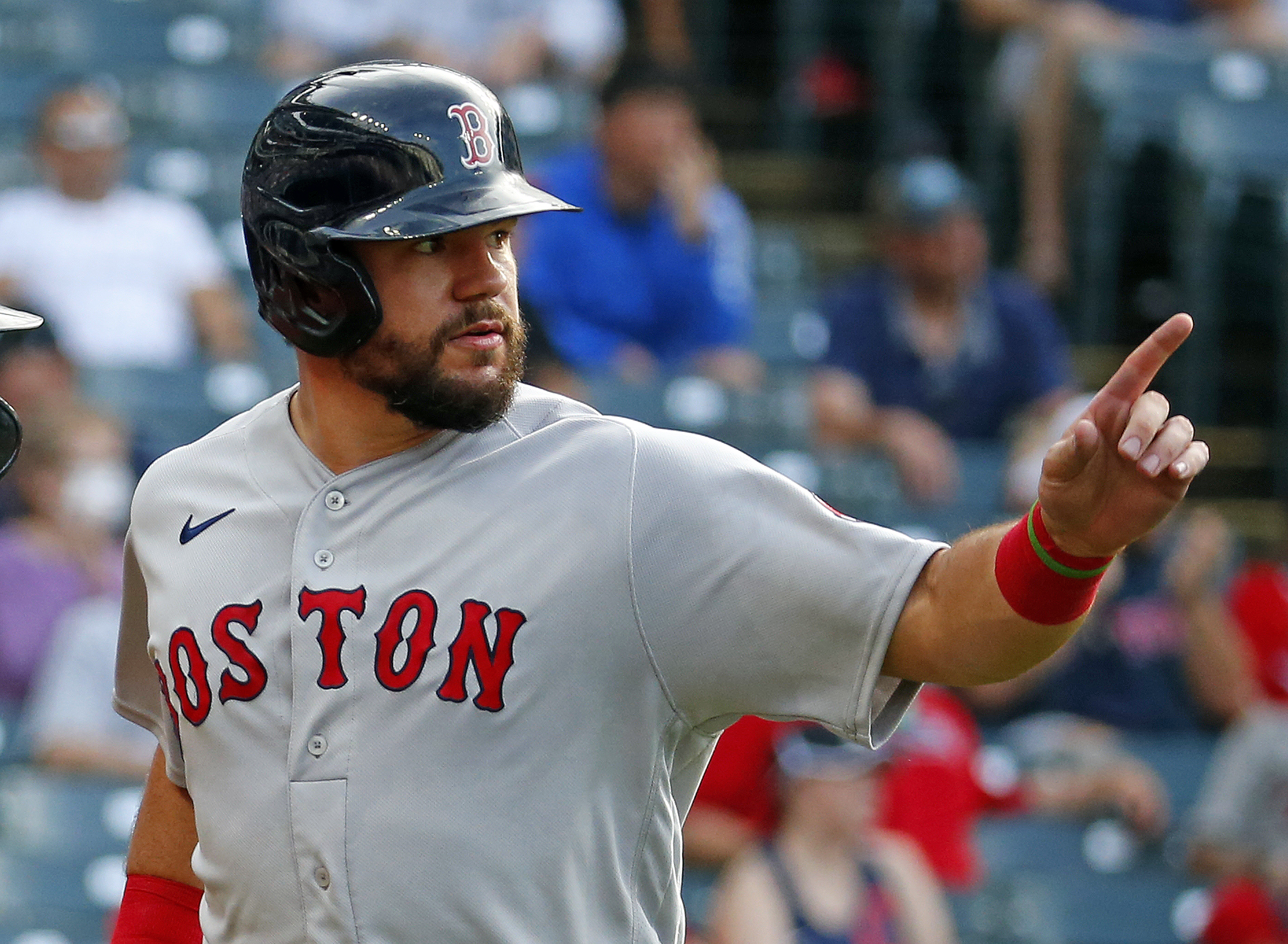 Kyle Schwarber of the Boston Red Sox celebrates after scoring on an RBI double off the bat of J.D. Martinez in the fifth inning against the Cleveland Indians during the game at Progressive Field on August 29, 2021 in Cleveland, Ohio.