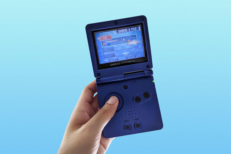 Hand holding a blue Game Boy Advance
