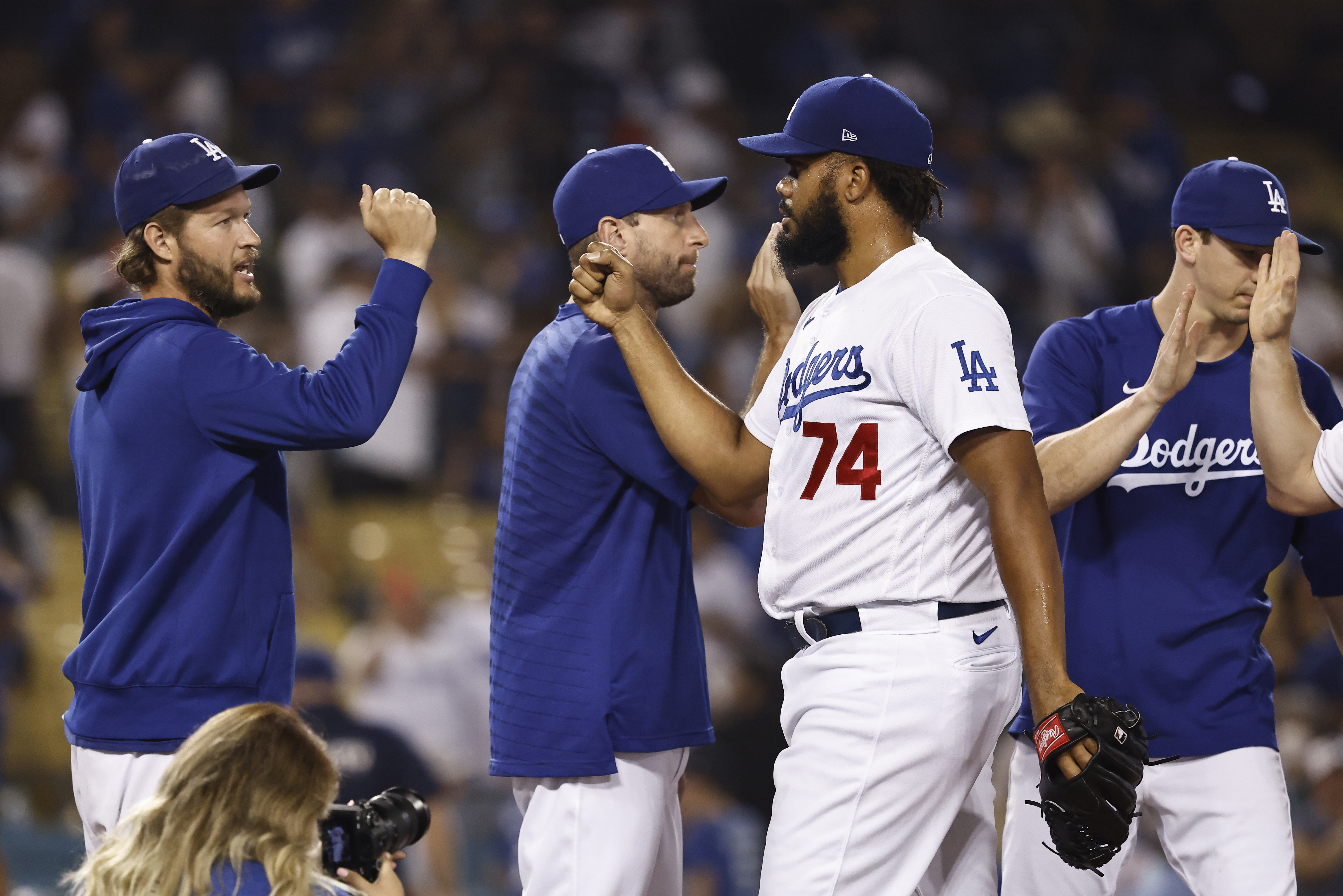 Kenley Jansen of the Los Angeles Dodgers celebrates with Clayton Kershaw, Max Scherzer and Walker Buehler after defeating the Pittsburgh Pirates 4-3 during the ninth inning at Dodger Stadium on August 17, 2021 in Los Angeles, California.
