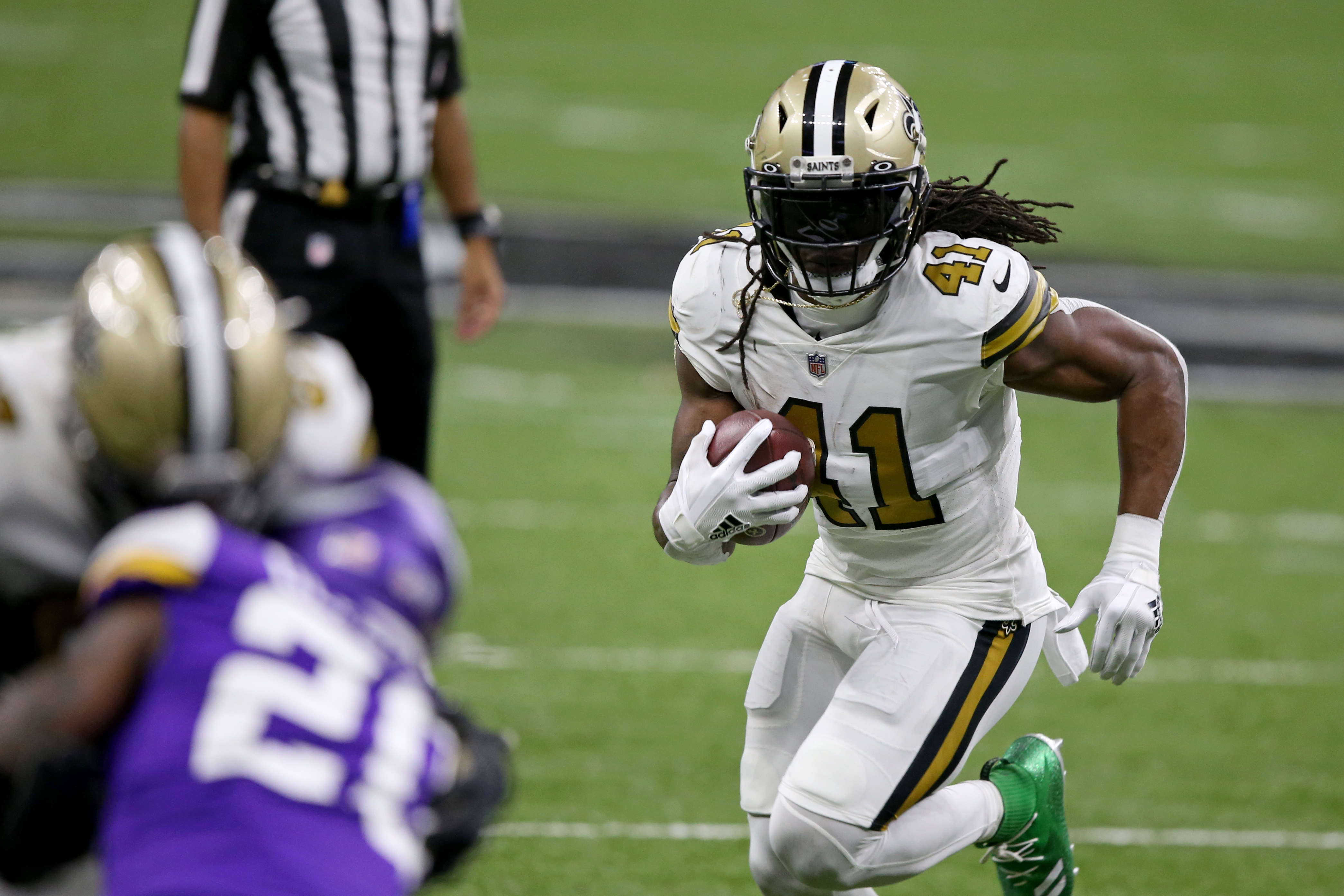 New Orleans Saints running back Alvin Kamara (41) runs against the Minnesota Vikings in the second quarter at the Mercedes-Benz Superdome.