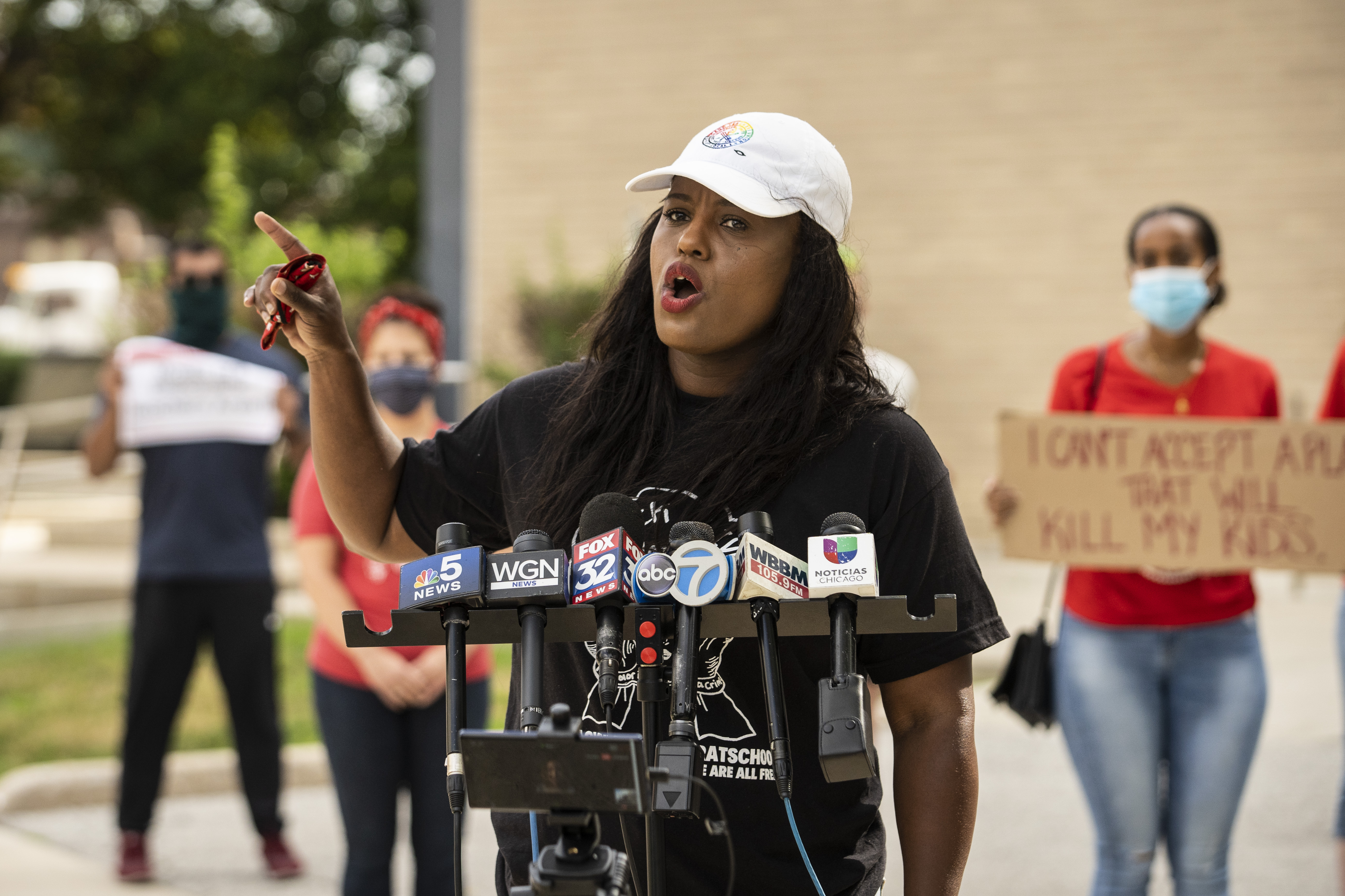 Stacy Davis Gates, vice president of the Chicago Teachers Union, speaks during a press conference outside CICS ChicagoQuest High School, at 1443 N. Ogden Ave., to demand that Chicago Public Schools opens virtually in the fall, Wednesday morning, July 22, 2020.