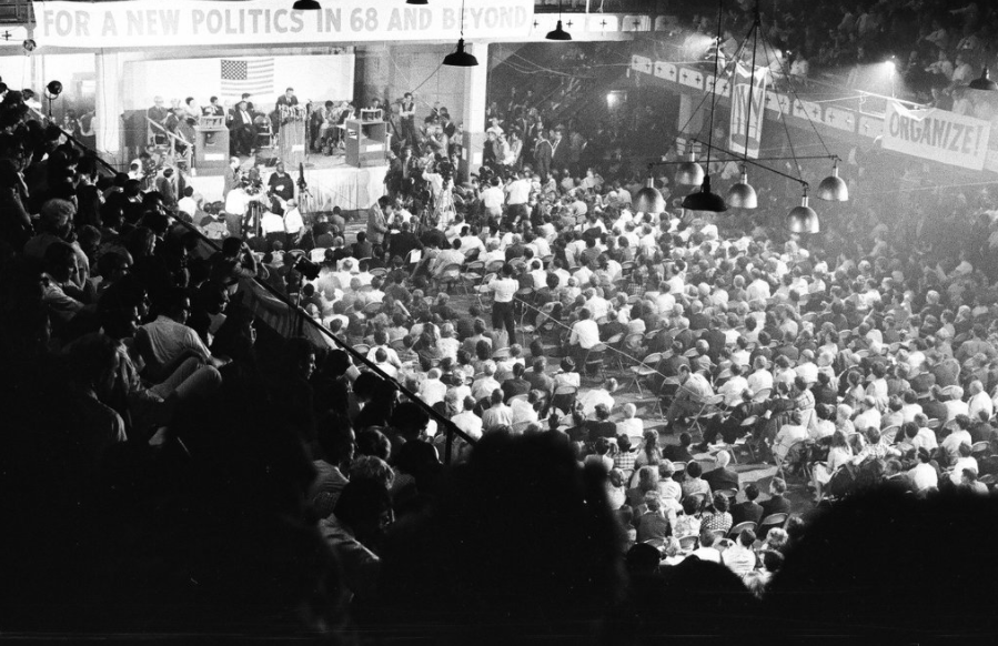 Crowd attends the National Conference of New Politics convention in the Chicago Coliseum to listen to speakers on Aug. 31, 1967