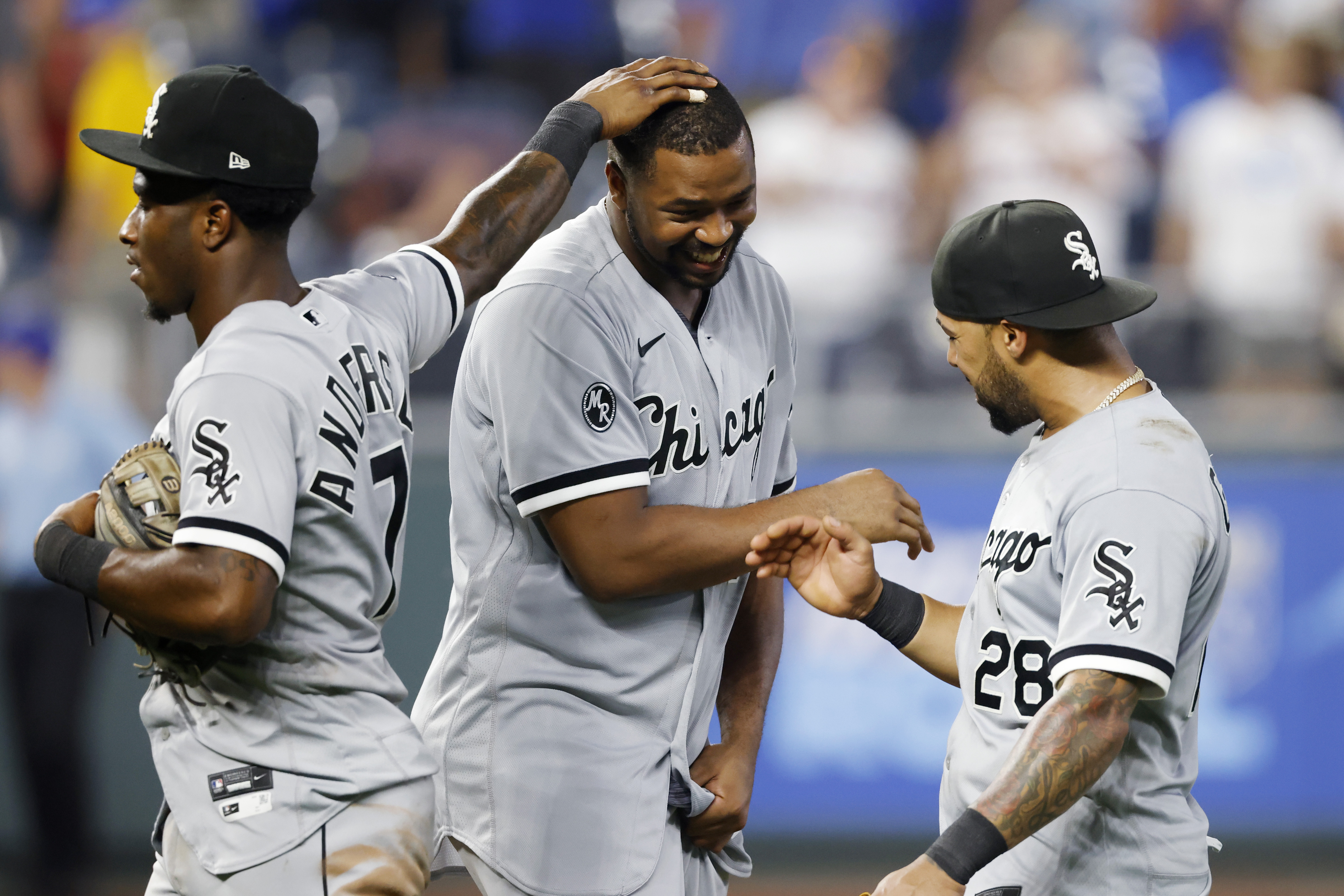 The White Sox' Eloy Jimenez, center, celebrates with teammates Tim Anderson and Leury Garcia after a game earlier this season.