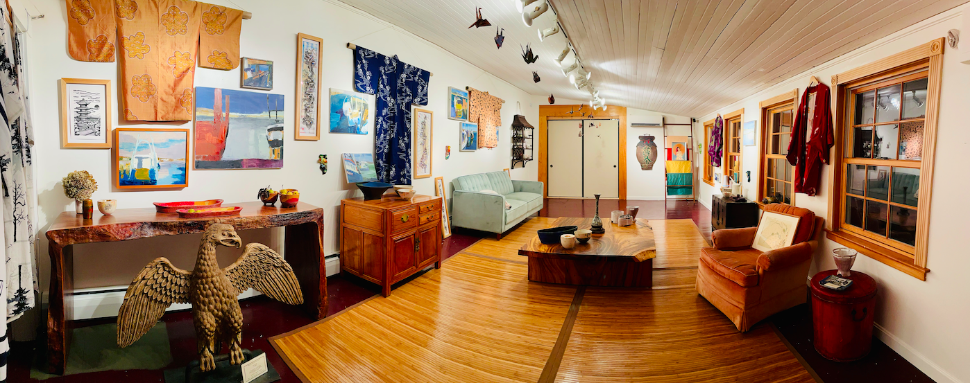 Panoramic interior shot of a brightly lit art gallery and shop featuring antique Japanese textiles, Cape Cod paintings, and more.