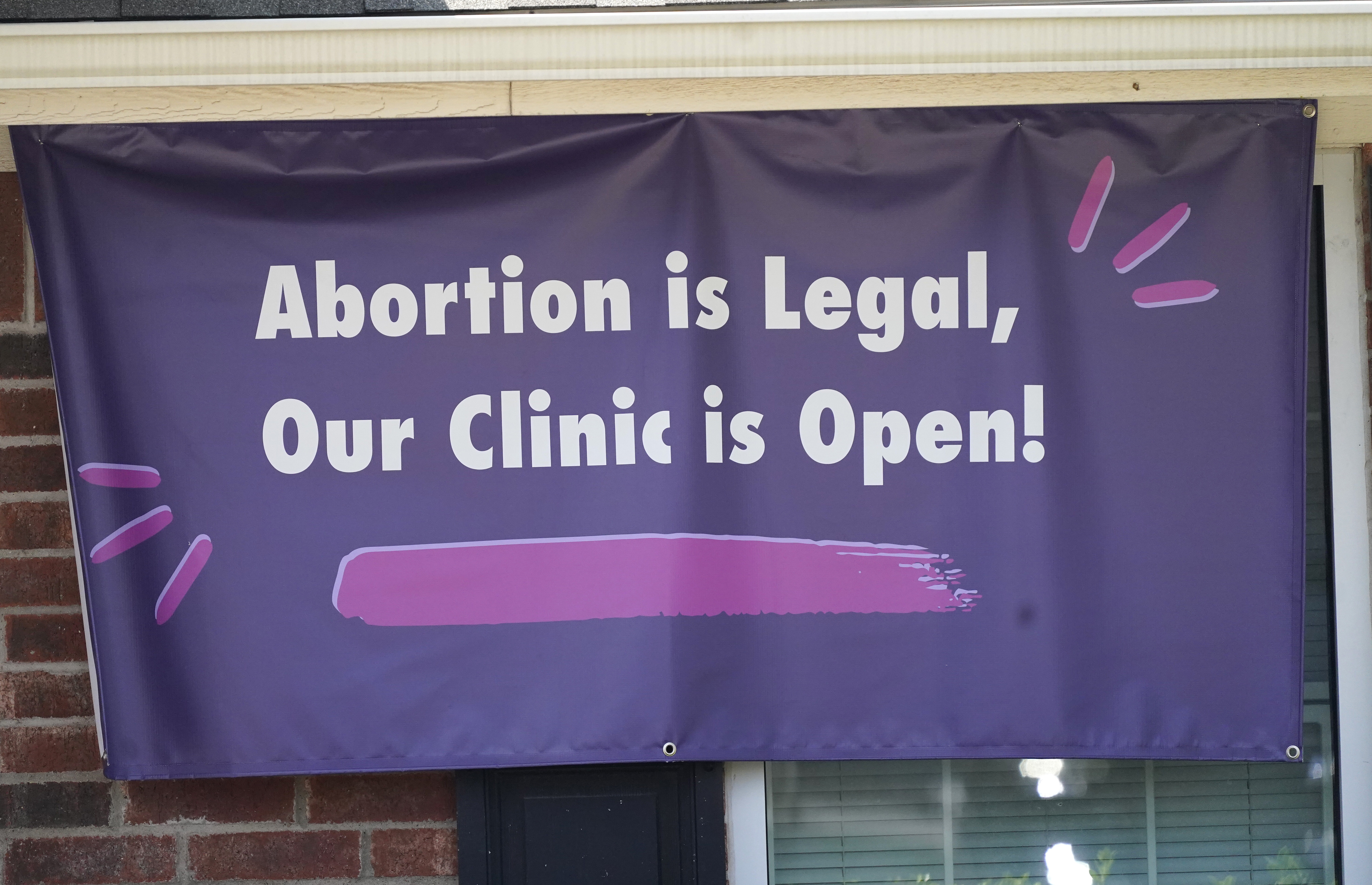 A signs hangs outside the Whole Women's Health Clinic in Fort Worth, Texas, Wednesday, Sept. 1, 2021. A Texas law banning most abortions in the state took effect at midnight,