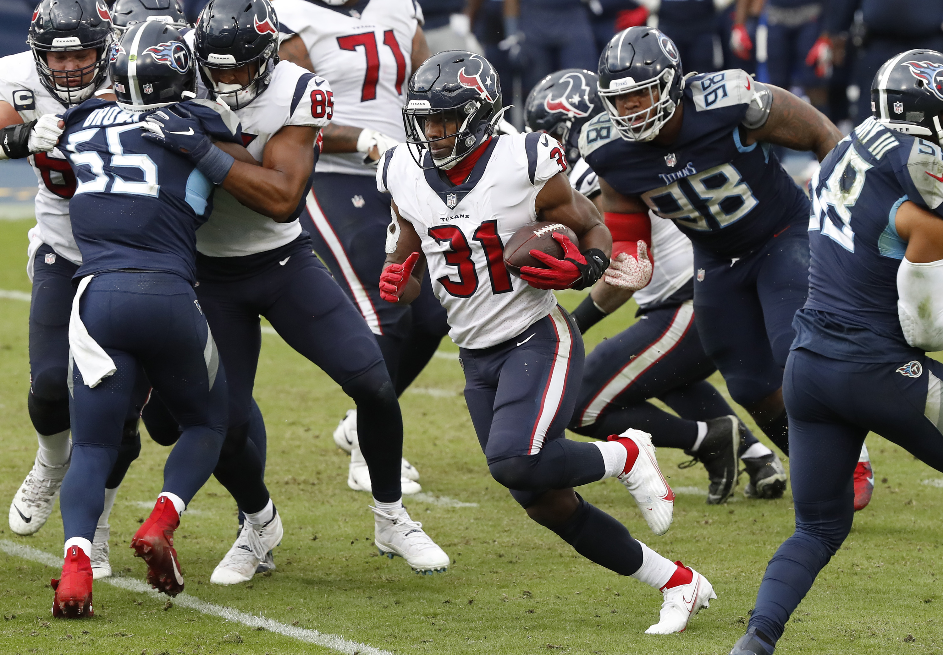 Running back David Johnson #31 of the Houston Texans runs with the ball in the second half of their game at Nissan Stadium on October 18, 2020 in Nashville, Tennessee.