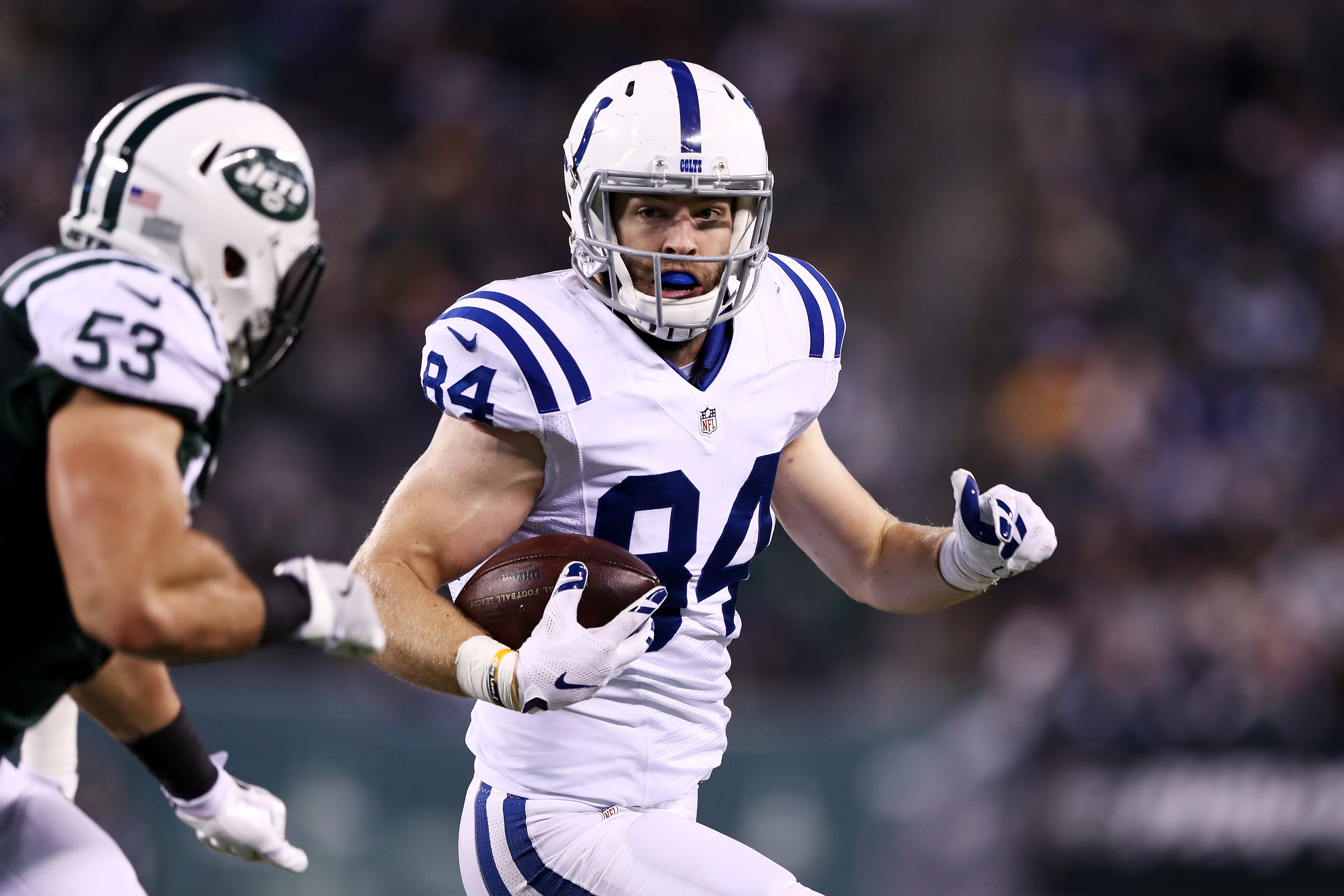 Jack Doyle of the Indianapolis Colts carries the ball against the New York Jets in the first half during their game at MetLife Stadium on December 5, 2016 in East Rutherford, New Jersey.