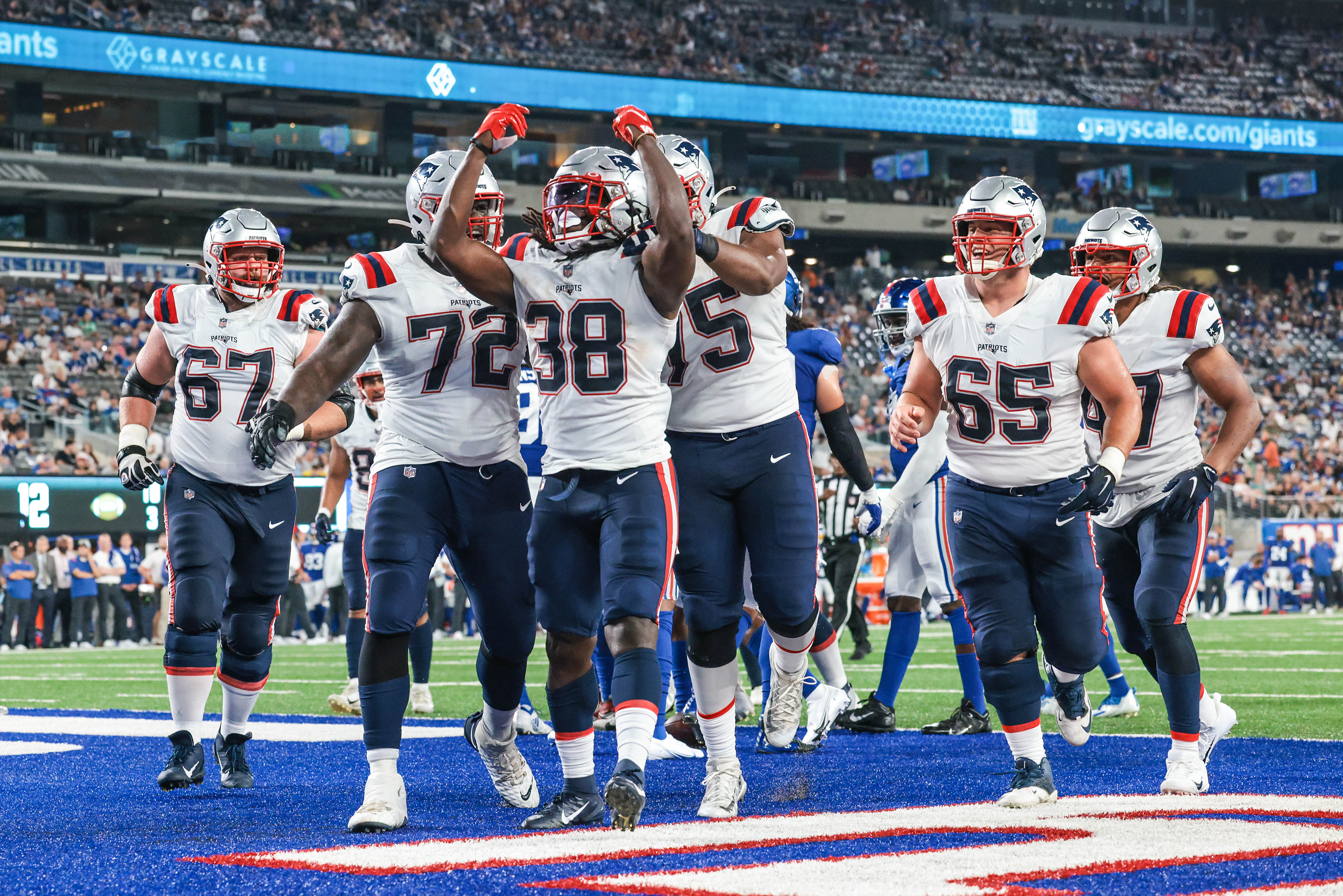 New England Patriots running back Rhamondre Stevenson (38) celebrates his touchdown with teammates during the second half against the New England Patriots at MetLife Stadium.