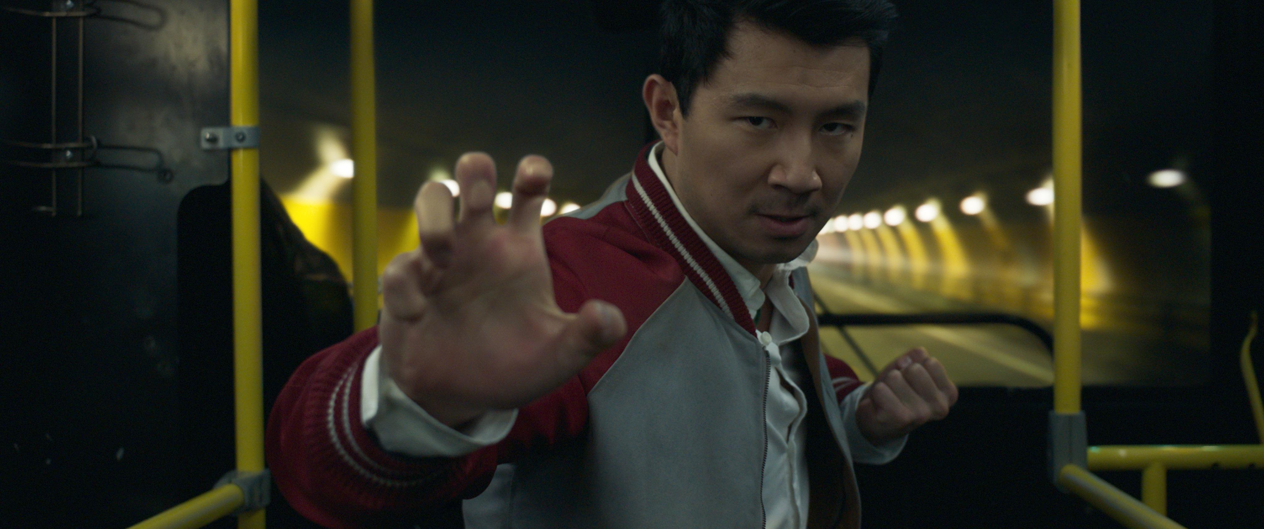 Actor Simu Liu in a fighting pose.