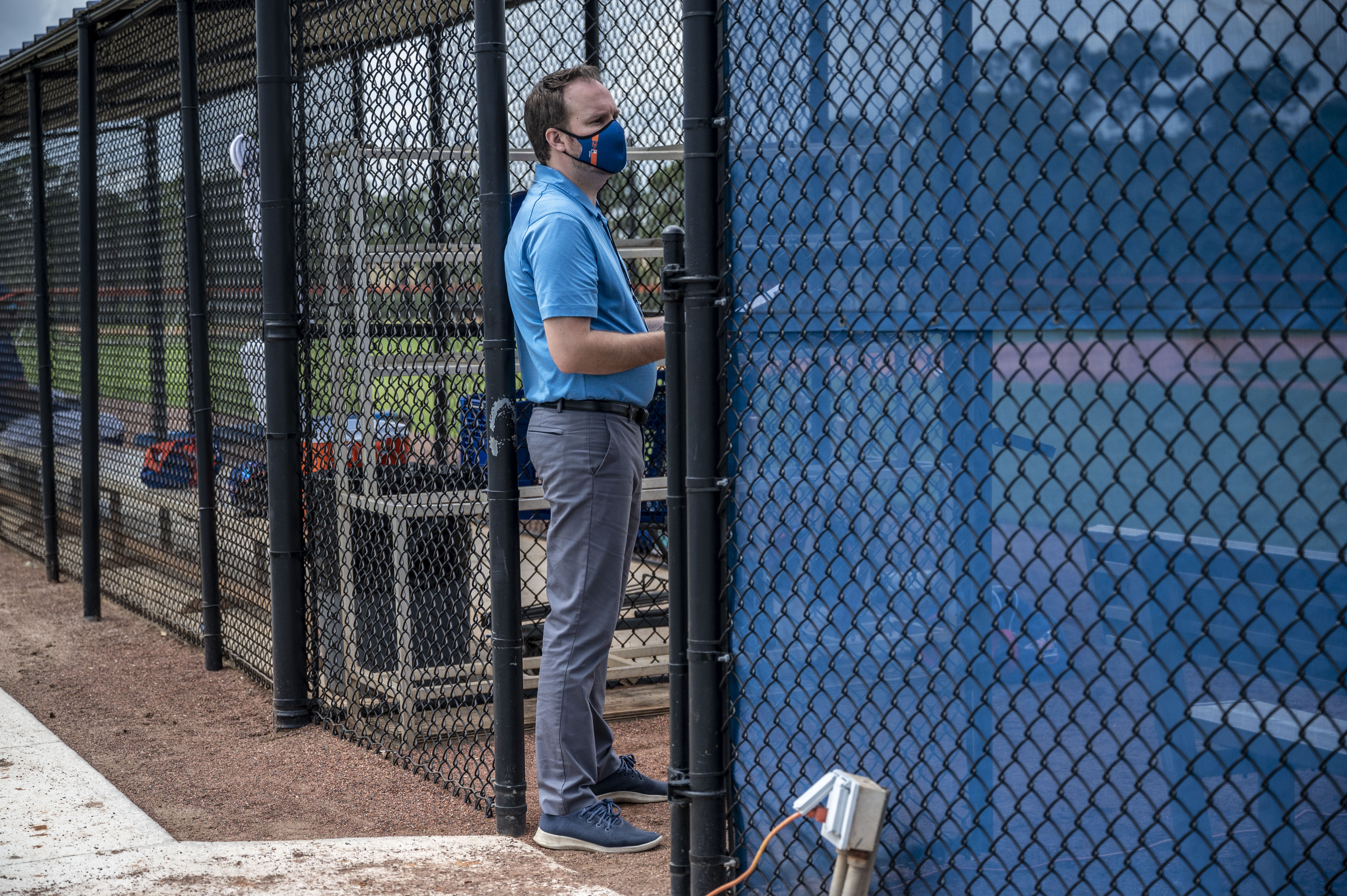 New York Mets' Acting General Manager Zack Scott watches his team's spring training workout
