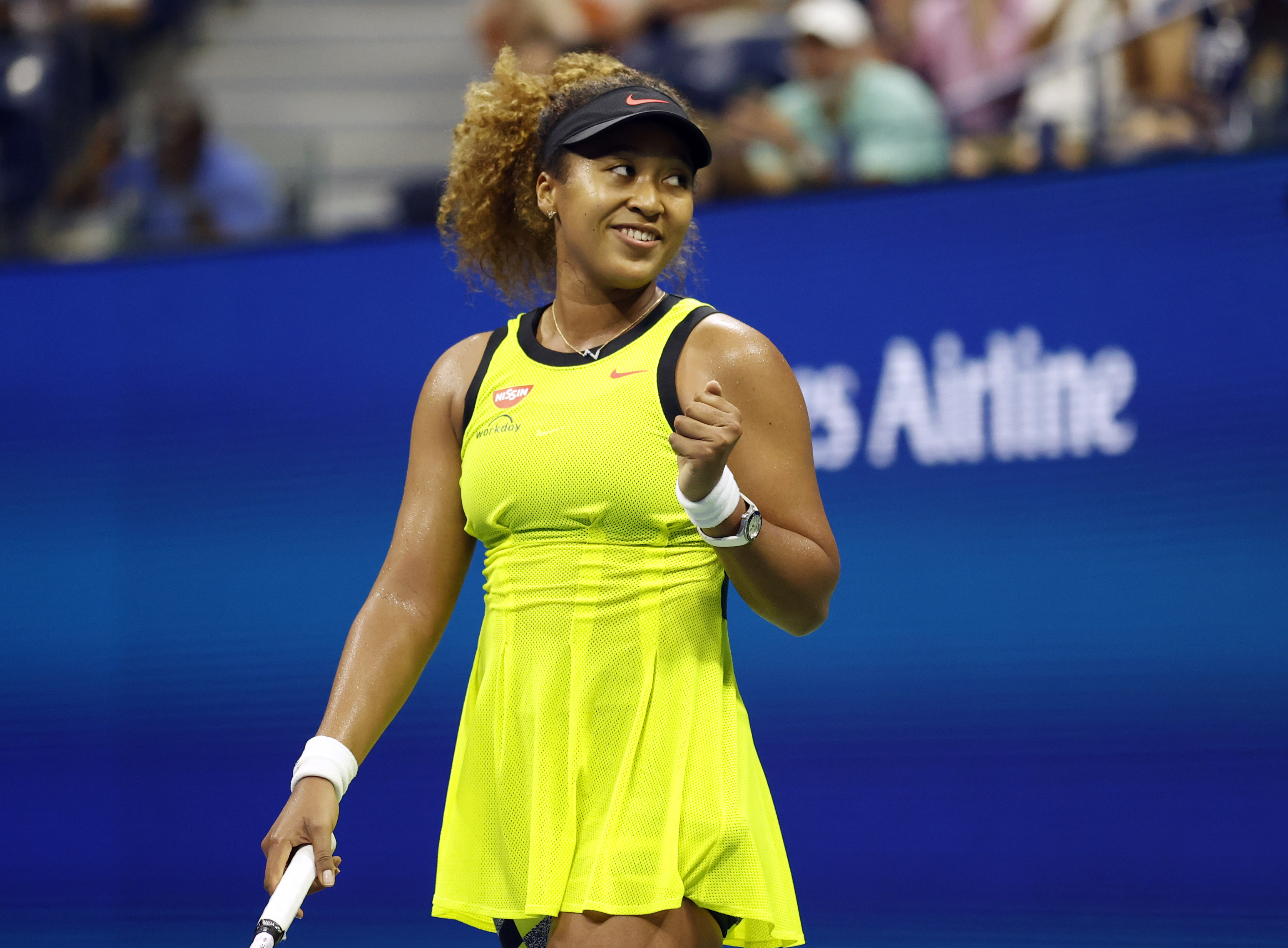 Naomi Osaka of Japan celebrates after recording match point Marie Bouzkova of Czech Republic in the first round on day one of the 2021 U.S. Open tennis tournament at USTA Billie King National Tennis Center.