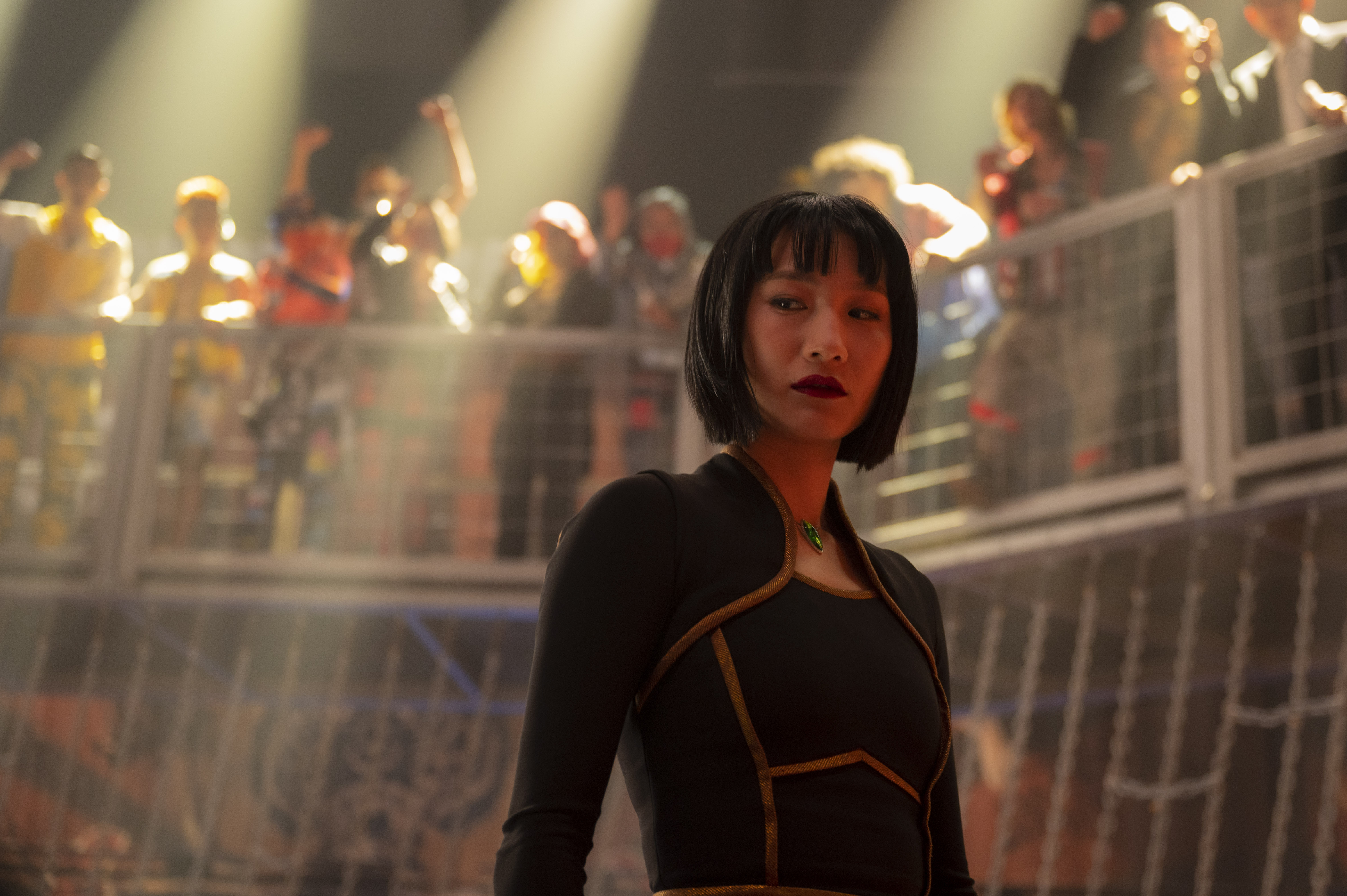 Xialing stands ready for a cage match in the Golden Daggers fight club in Shang-Chi and the Legend of the Ten Rings.