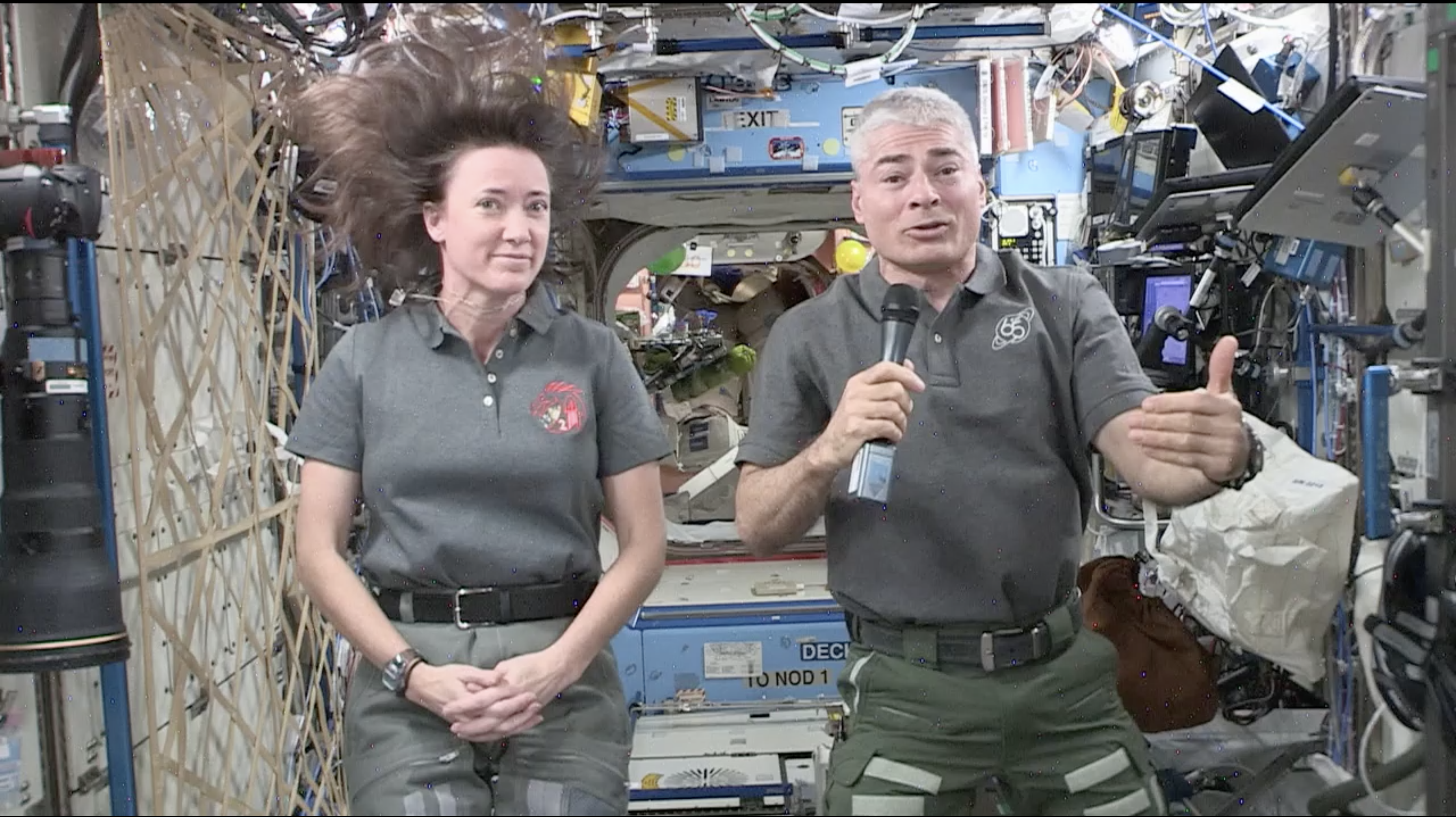 NASA astronauts Megan MacArthur (left) and Mark Vande Hei (right) speak with REACH podcast hosts Wednesday morning aboard the International Space Station on Expedition 65.