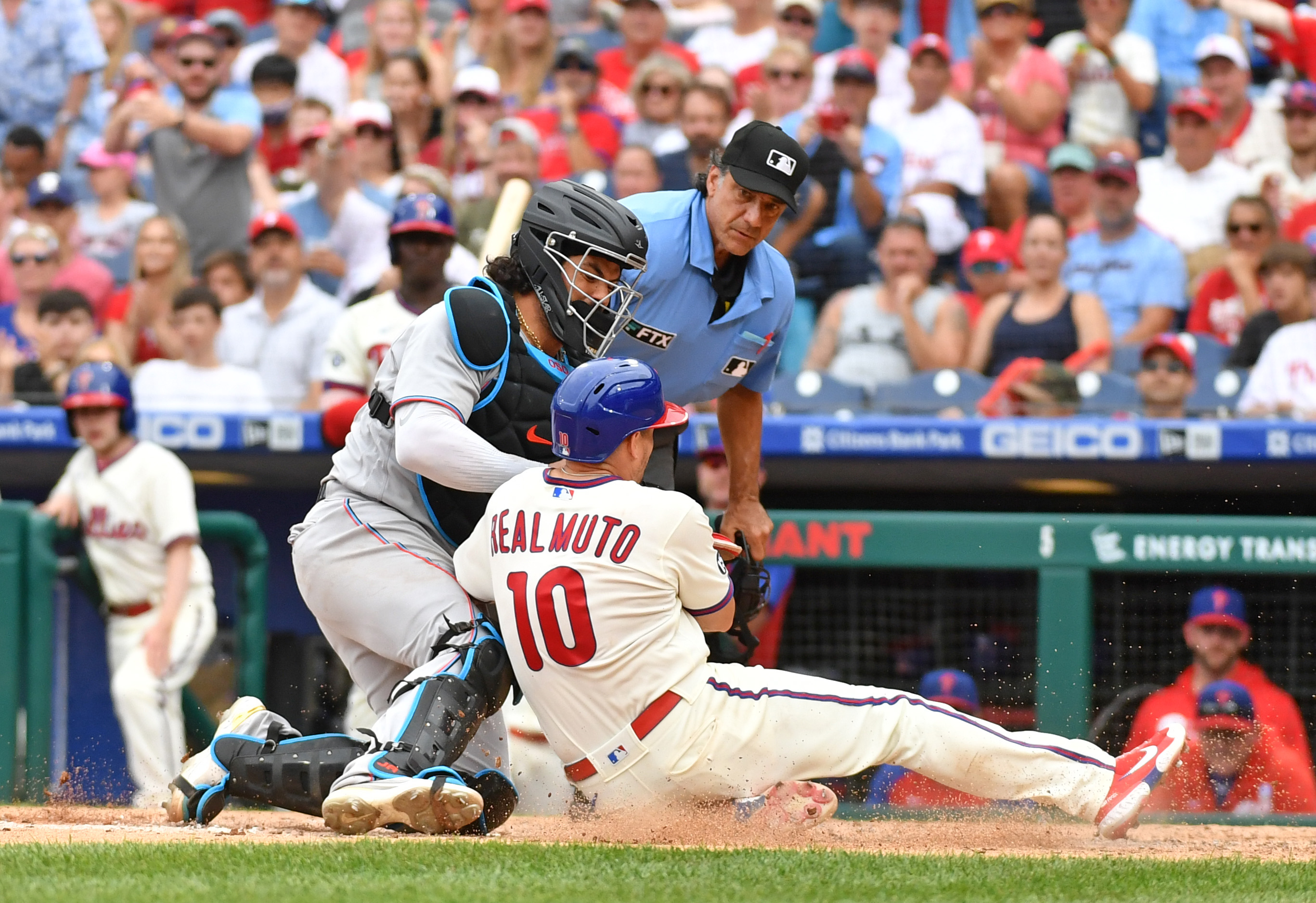 Miami Marlins catcher Jorge Alfaro (38) tags out Philadelphia Phillies catcher J.T. Realmuto (10) during the sixth inning at Citizens Bank Park.