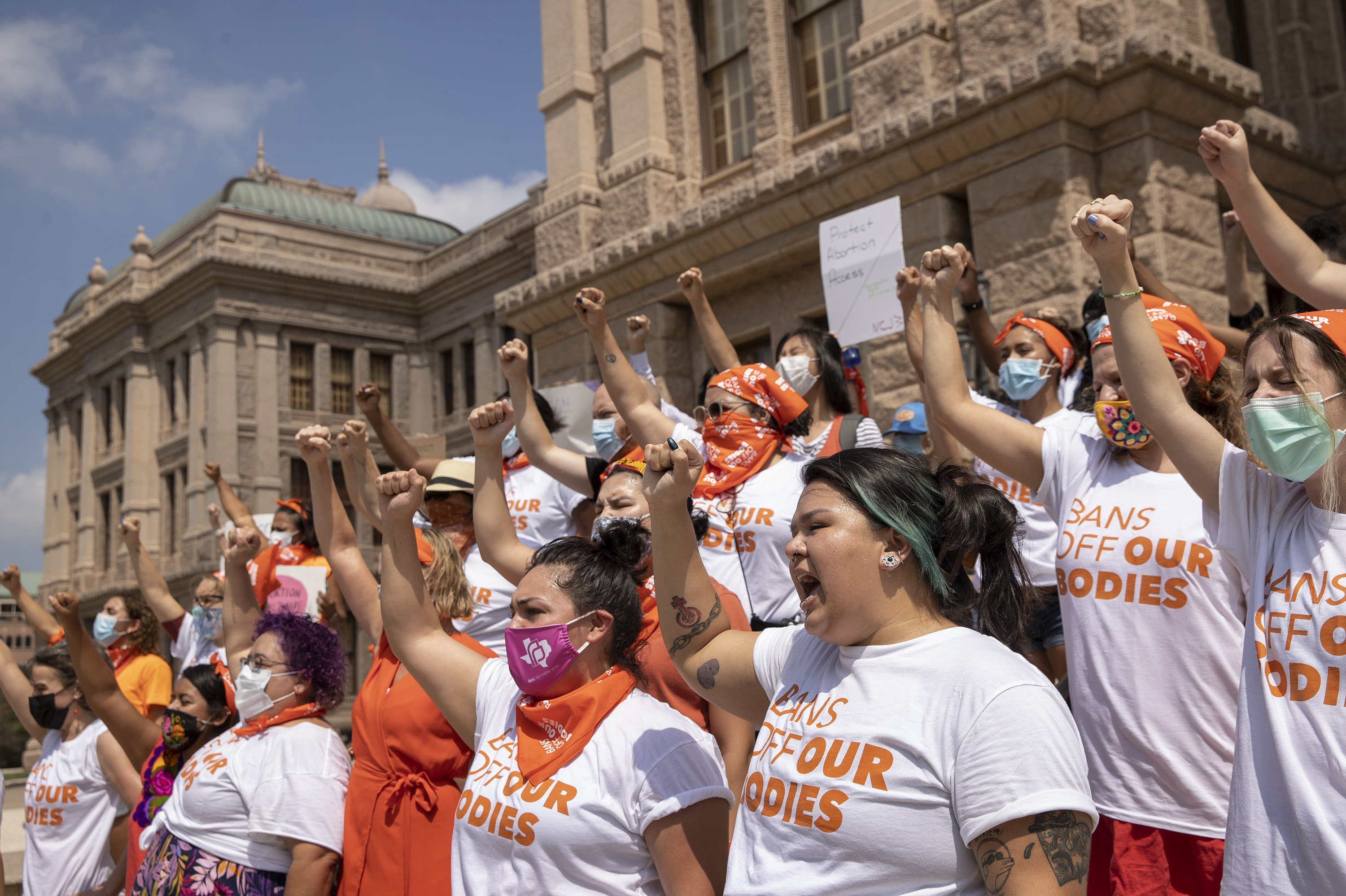 Women protest against the six-week abortion ban at the Capitol in Austin, Texas, on Wednesday, Sept. 1, 2021.