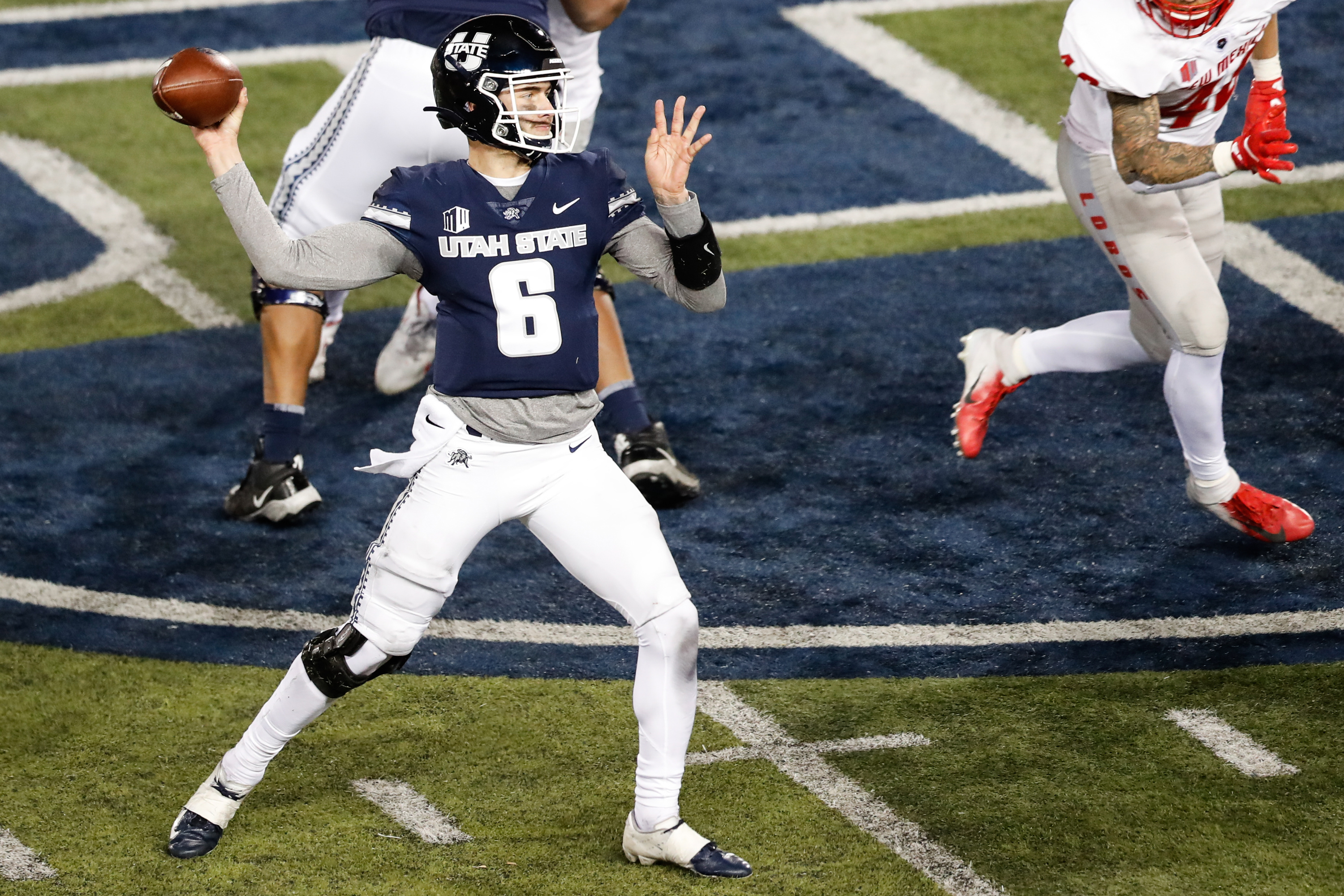 Utah State Aggies quarterback Andrew Peasley sets to pass against the New Mexico Lobos defense.