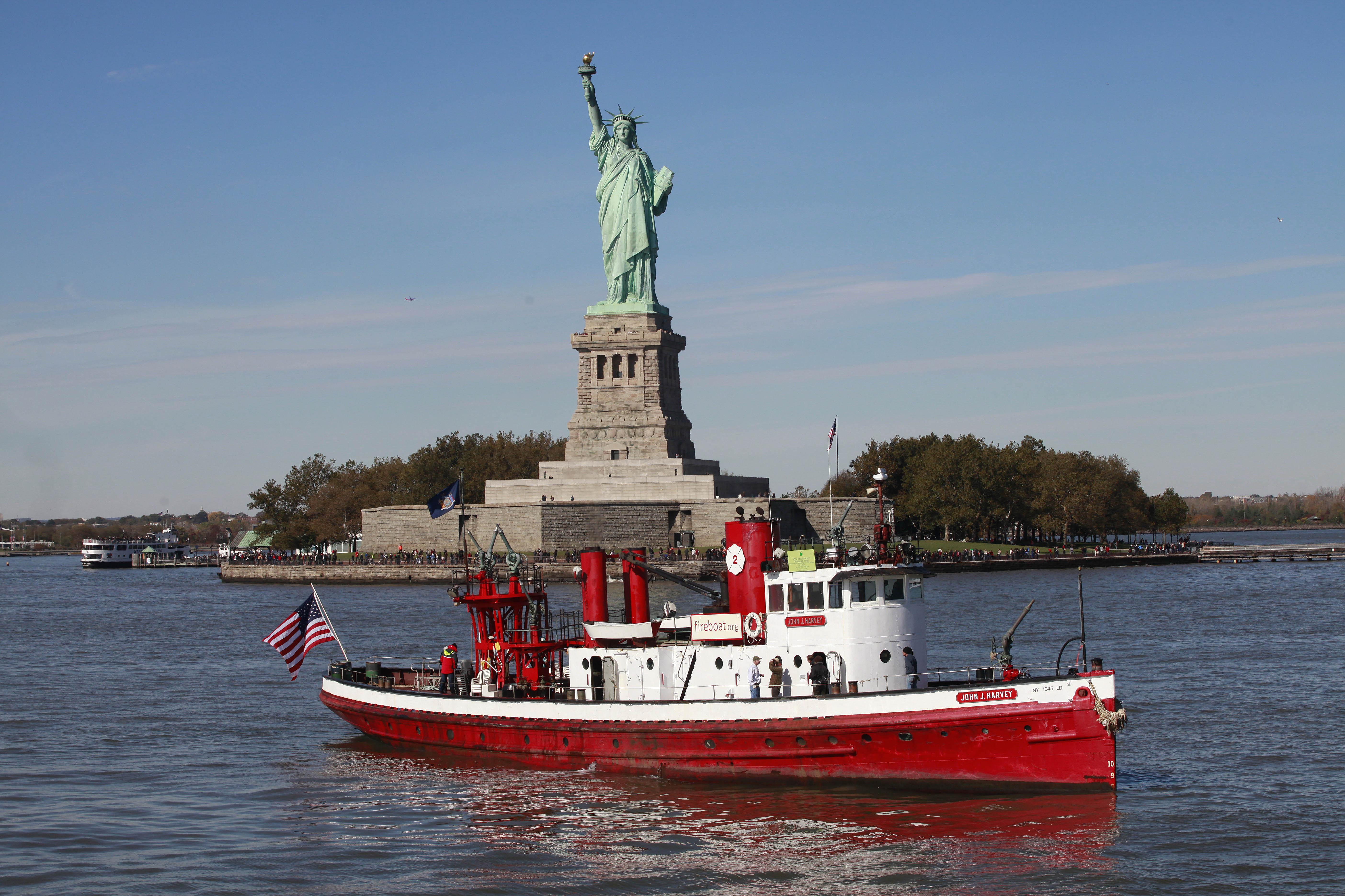 The fireboat John J. Harvey passes the Statue of Liberty on Friday, Oct. 28, 2011, in New York Harbor.