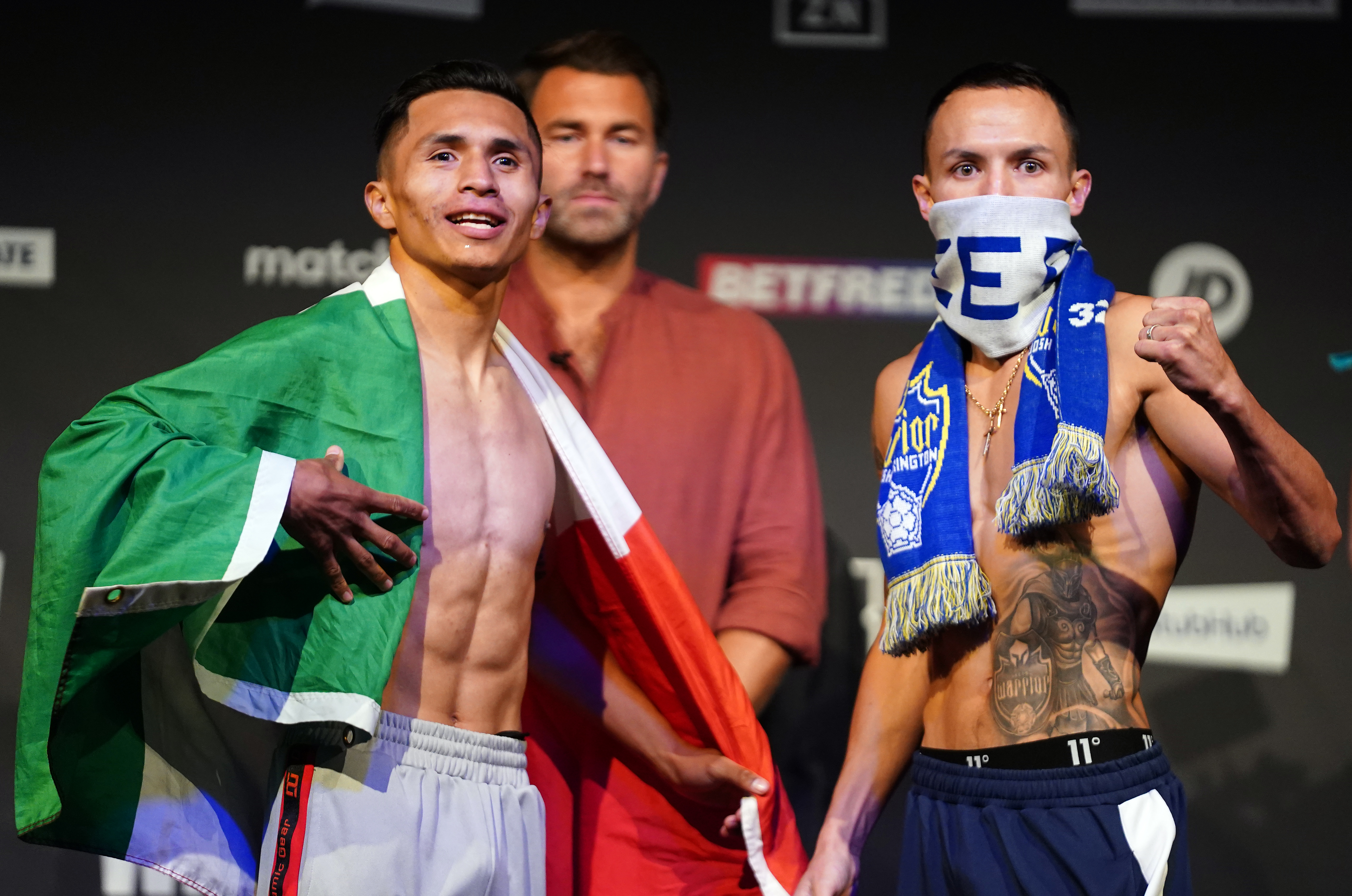 Josh Warrington (right) and Mauricio Lara during the weigh-in at the New Dock Hall, Leeds.