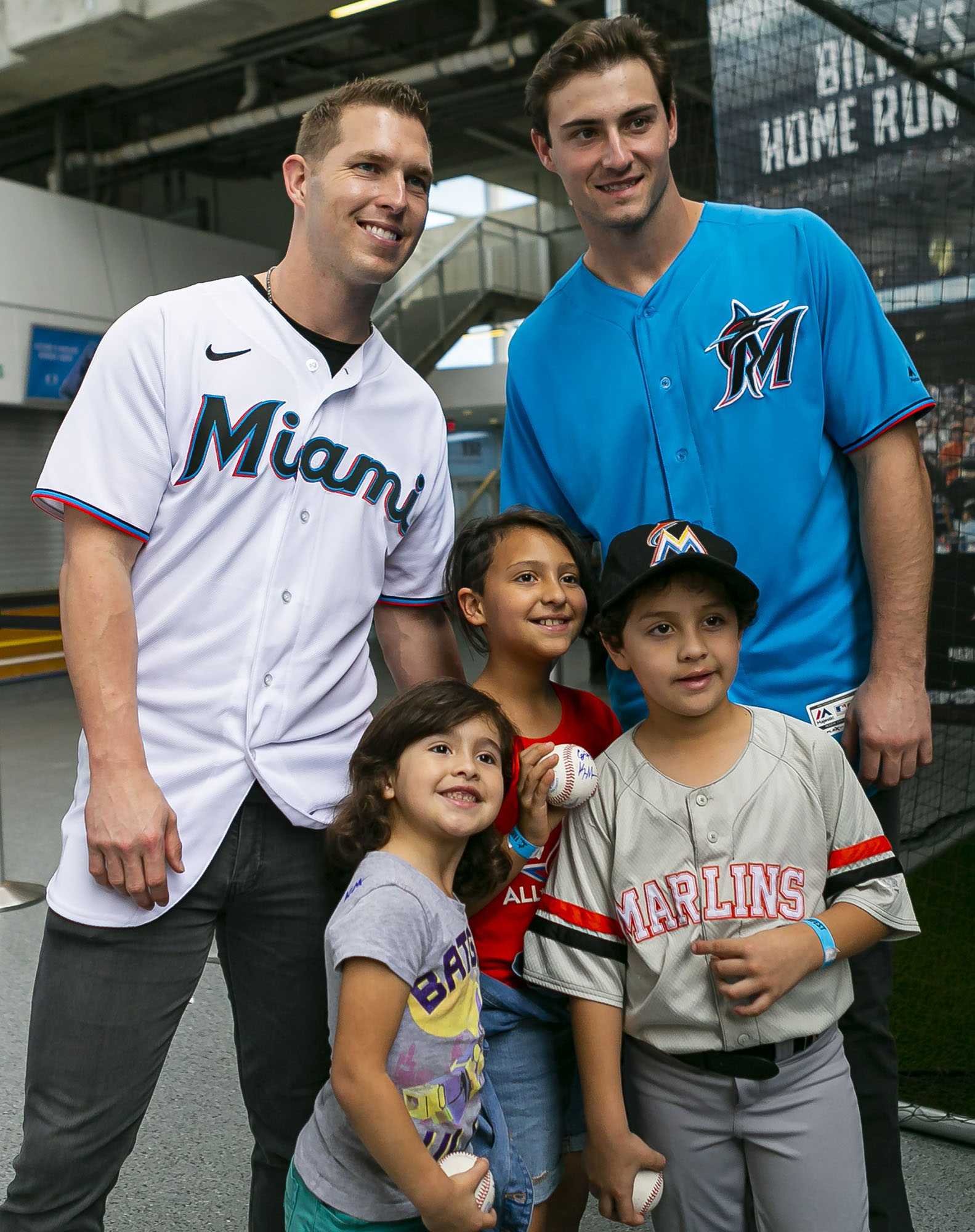 Kameron Misner takes a photo with young children during the 2020 FanFest at Marlins Park