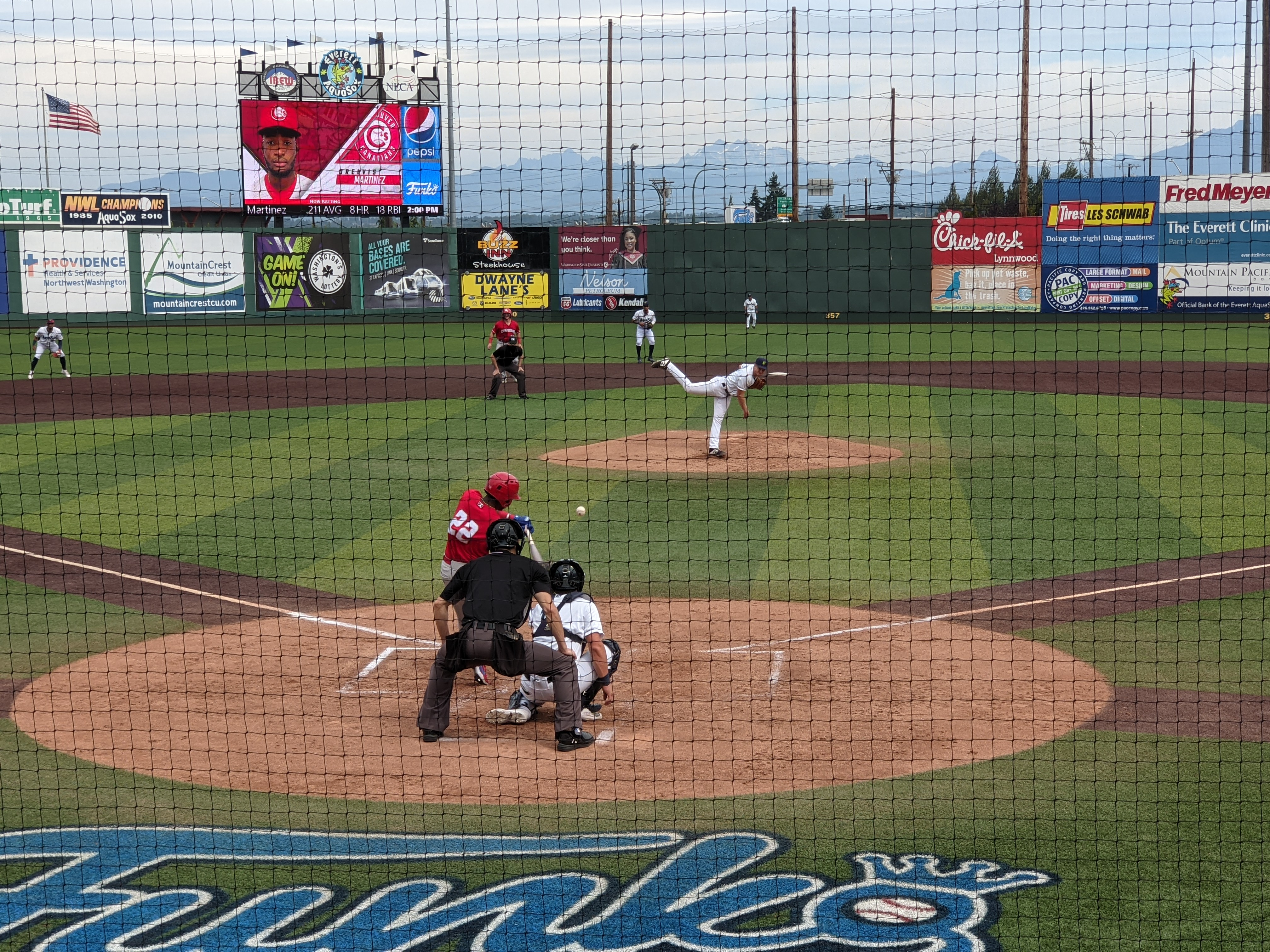 Orelvis Martinez (#22) of the Vancouver Canadians connects with a Tim Elliott pitch for a home run against the Everett AquaSox at Funko Field in Everett, WA.