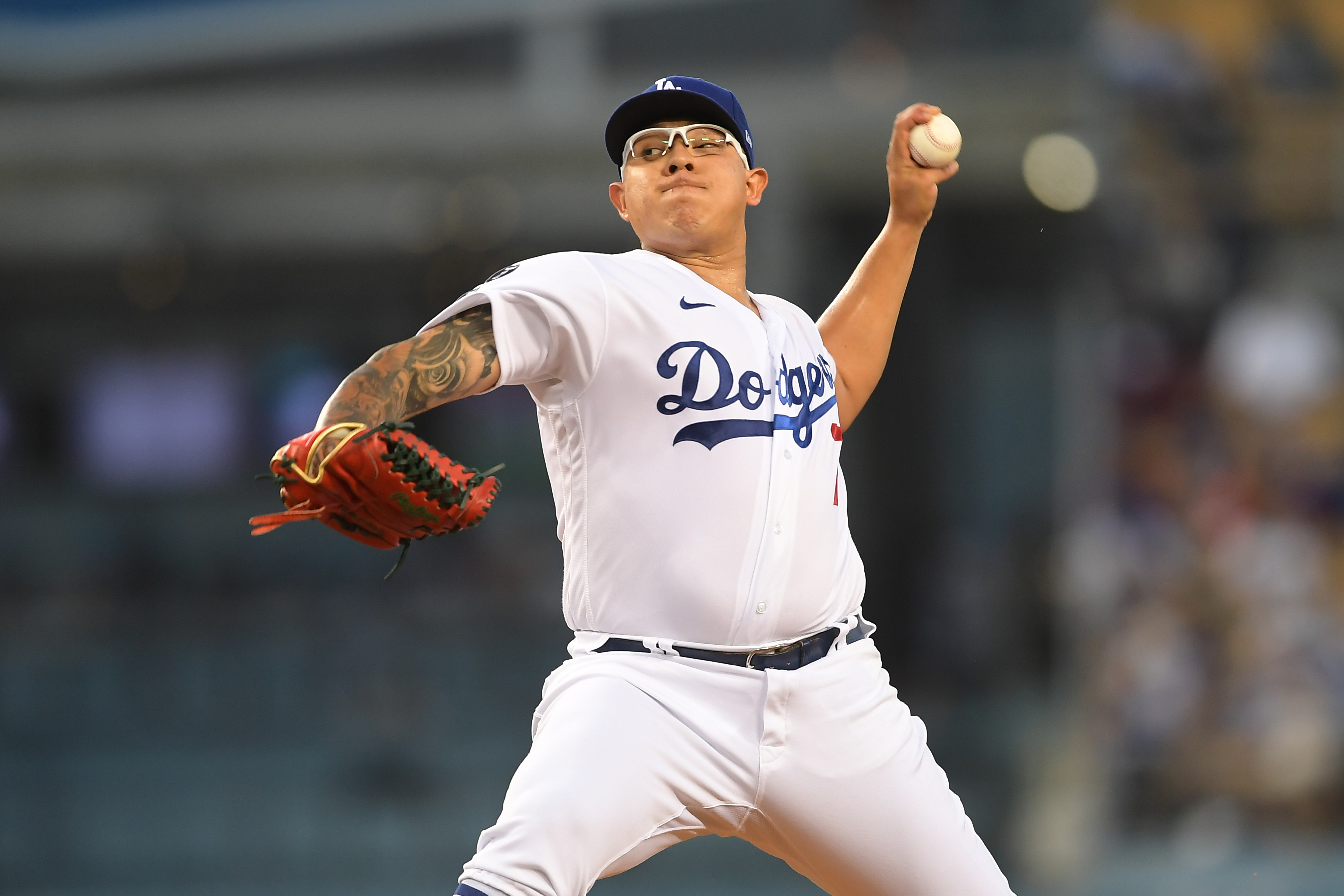 Los Angeles Dodgers starting pitcher Julio Urias (7) pitches in the first inning of the game against the Atlanta Braves at Dodger Stadium.