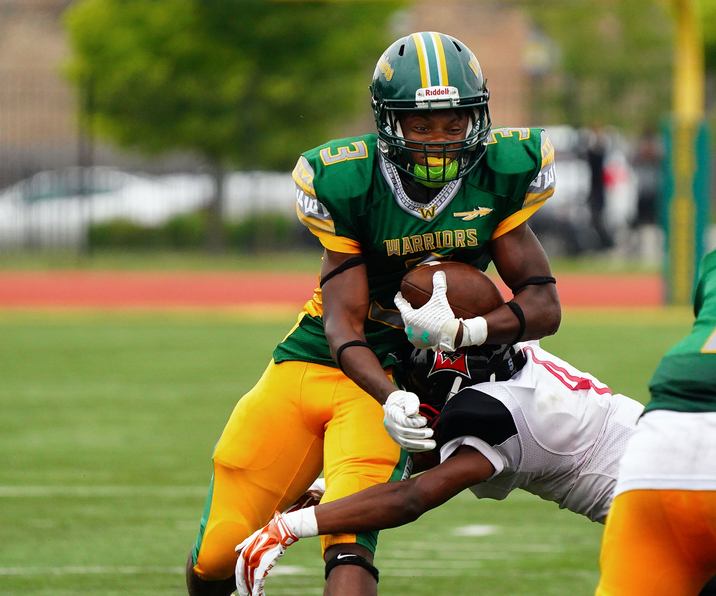 Westinghouse's Dewayne Brooks (3) is wrapped up by Raby's Jaylin Leggins (4).