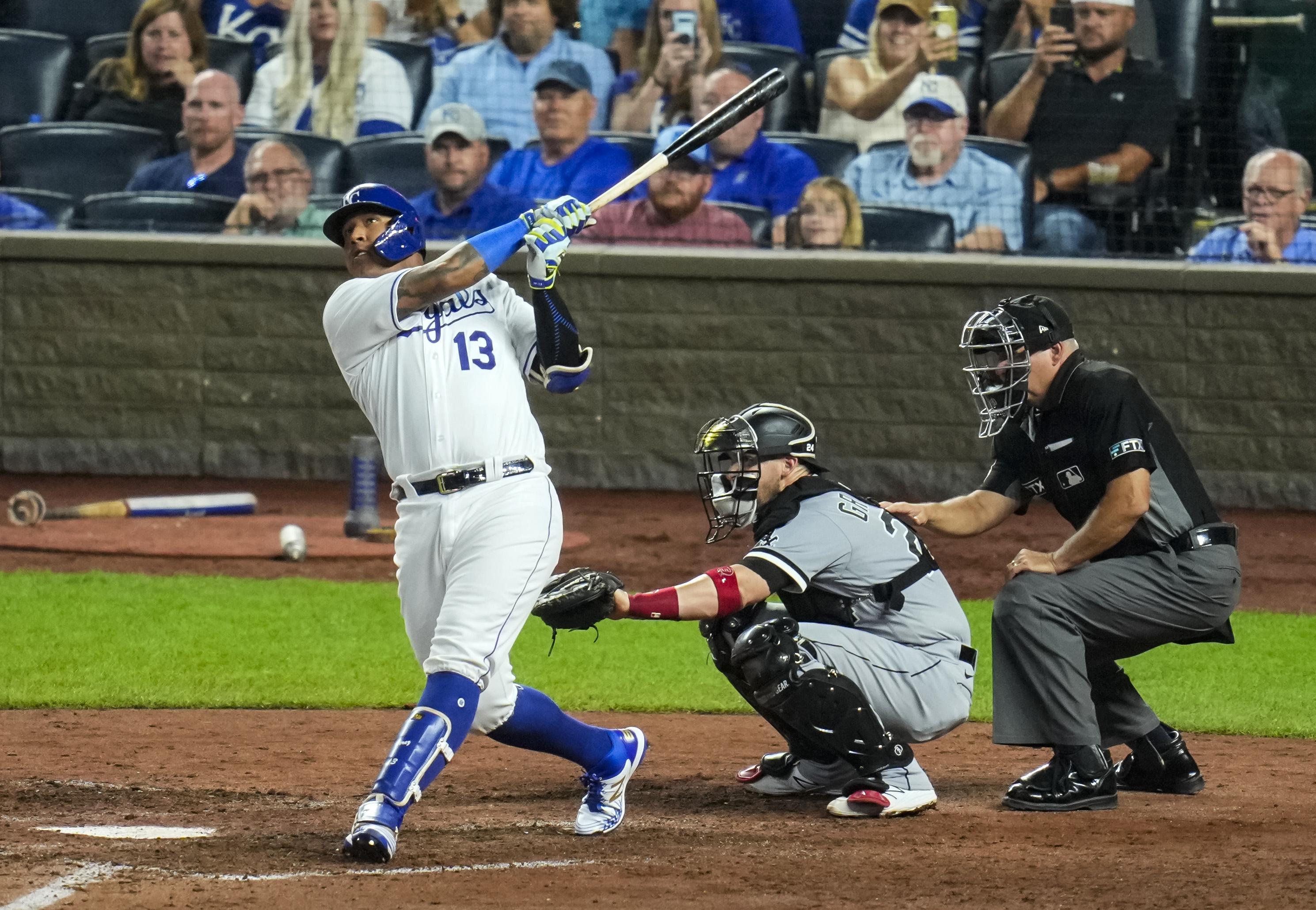 Salvador Perez follows through after hitting his three-run home run
