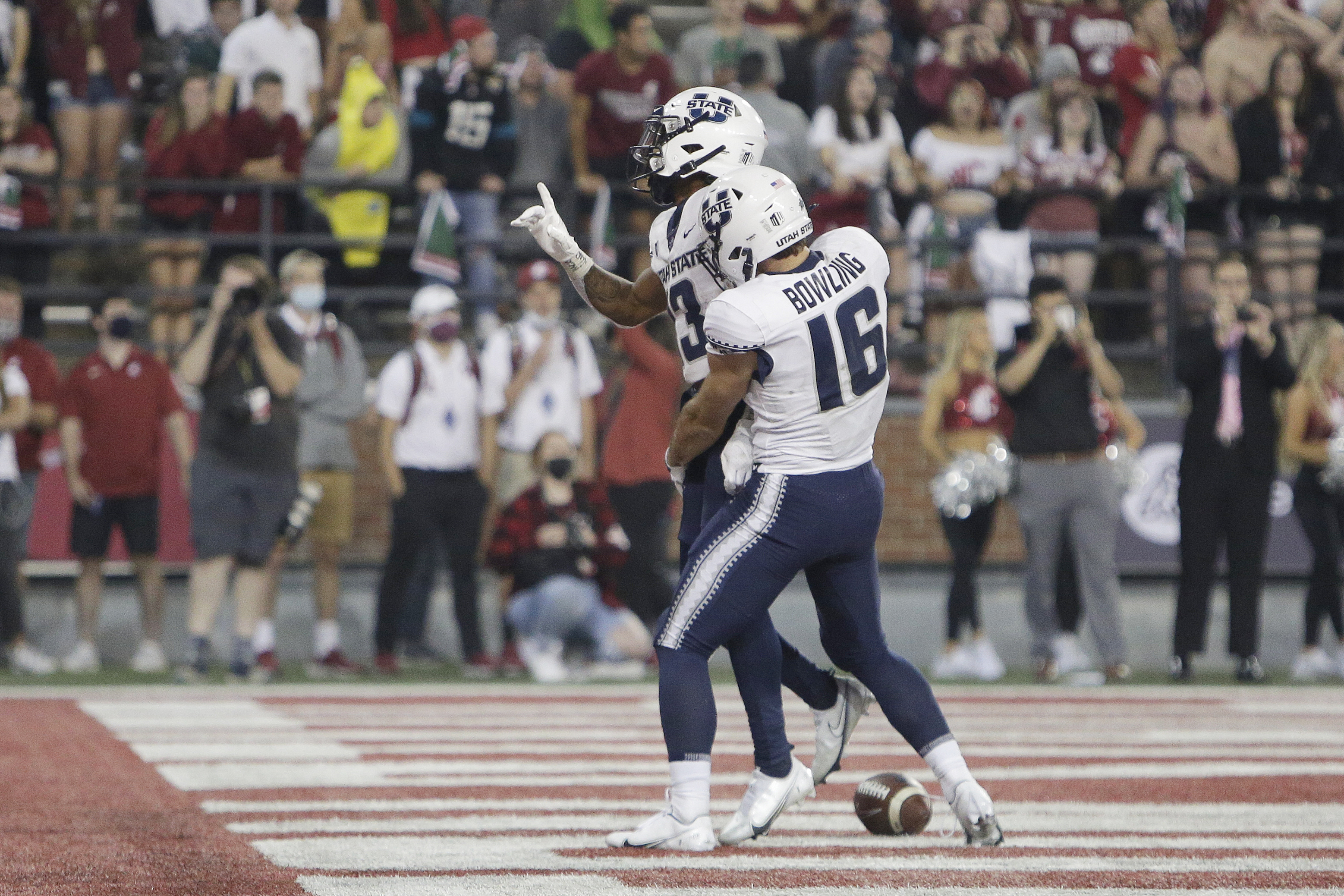 Utah State wide receiver Deven Thompkins, left, celebrates his touchdown with wide receiver Brandon Bowling against Washington State.