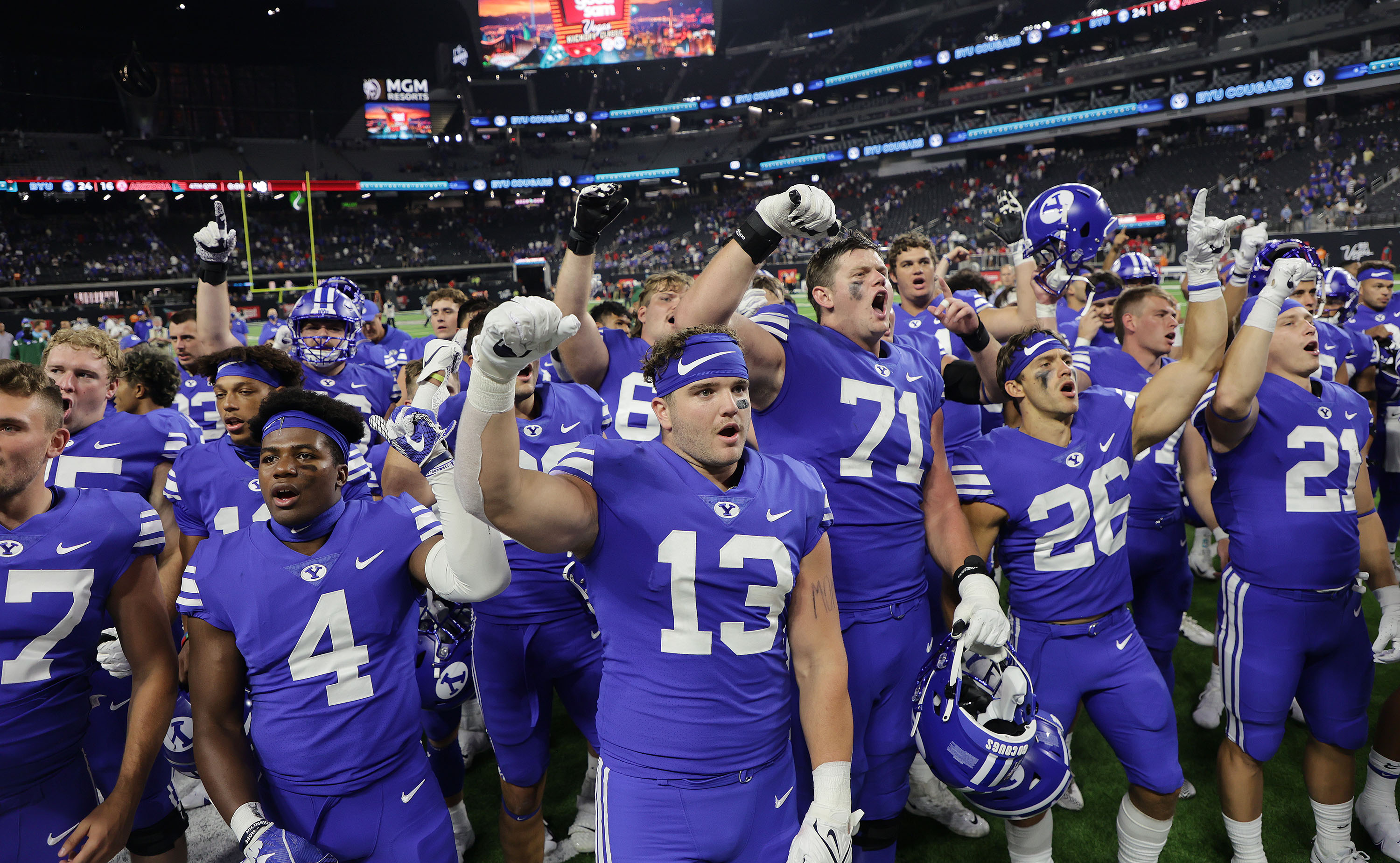 Brigham Young Cougars sing the fight song during the Vegas Kickoff Classic in Las Vegas on Saturday, Sept. 4, 2021. BYU won 24-16.