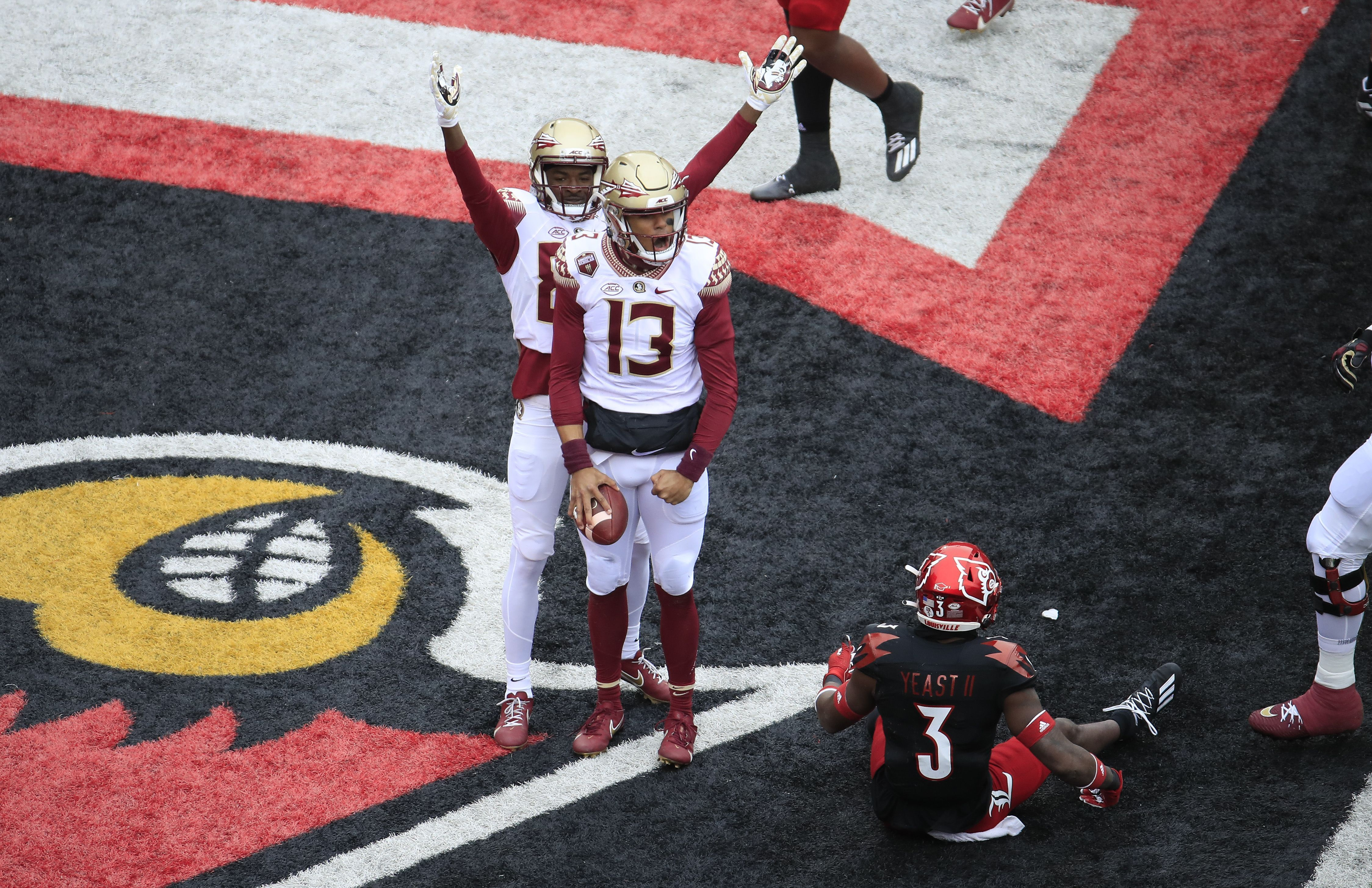 Jordan Travis of the Florida State Seminoles celebrates after running for a touchdown against the Louisville Cardinals at Cardinal Stadium on October 24, 2020 in Louisville, Kentucky.