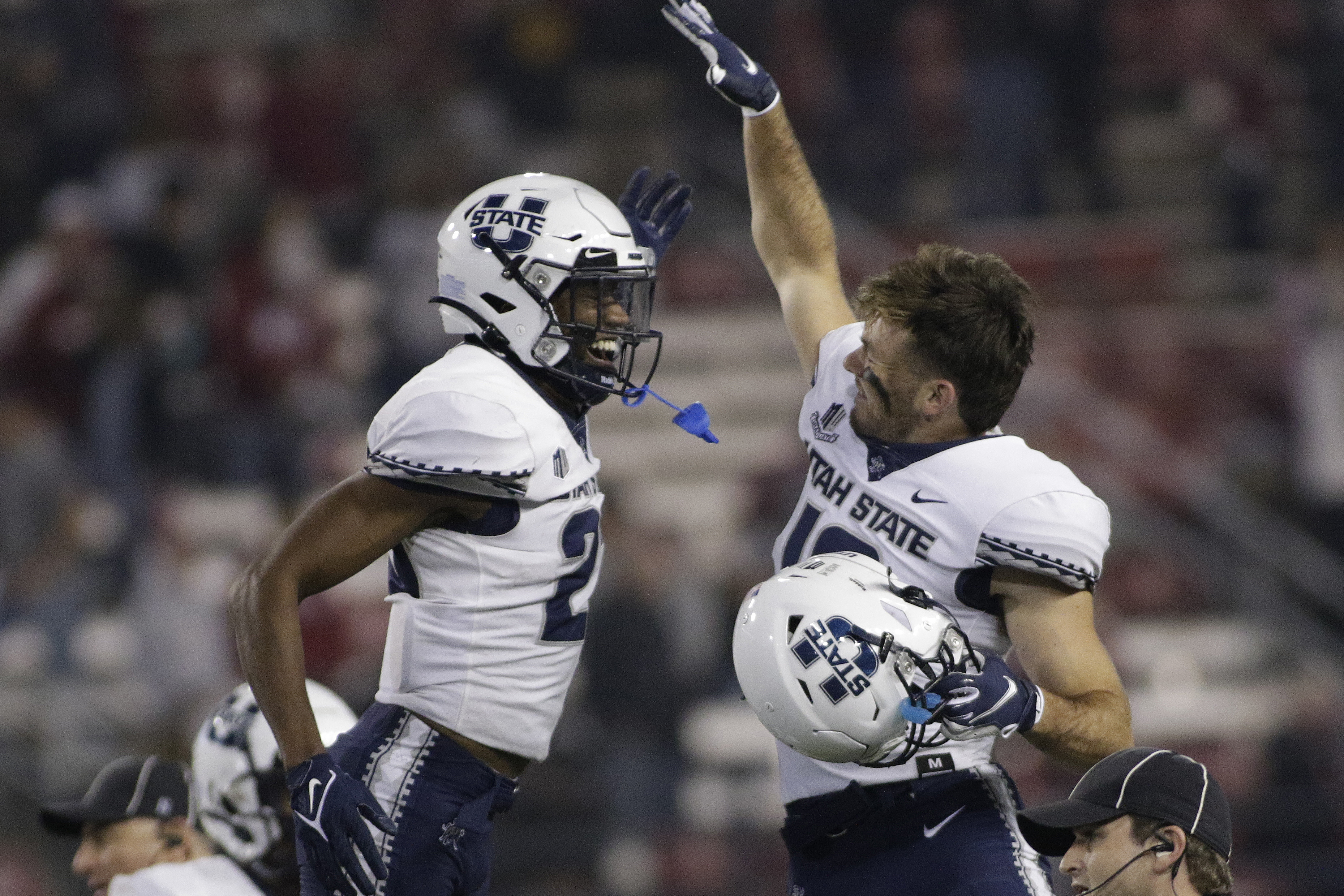 Utah State safety Dominic Tatum, left, and wide receiver Brandon Bowling celebrate the team's 26-23 win against Washington State.