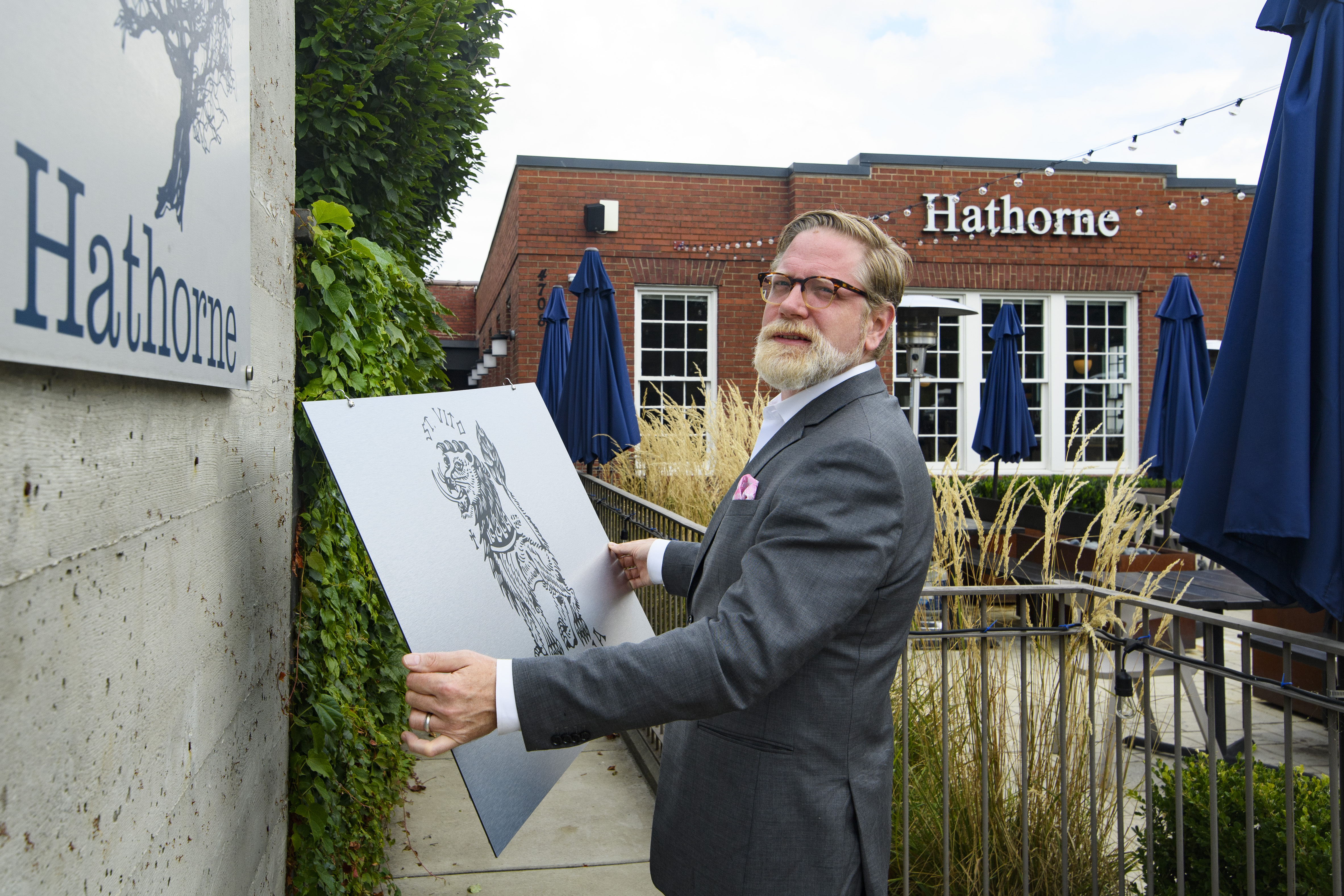 Hathorne restaurant owner John Stephenson holds a sign for a pop-up restaurant in Nashville, Tennessee. Stephenson hosts temporary restaurants, known as pop-ups which he lets use his space, in an effort to help them weather the pandemic.