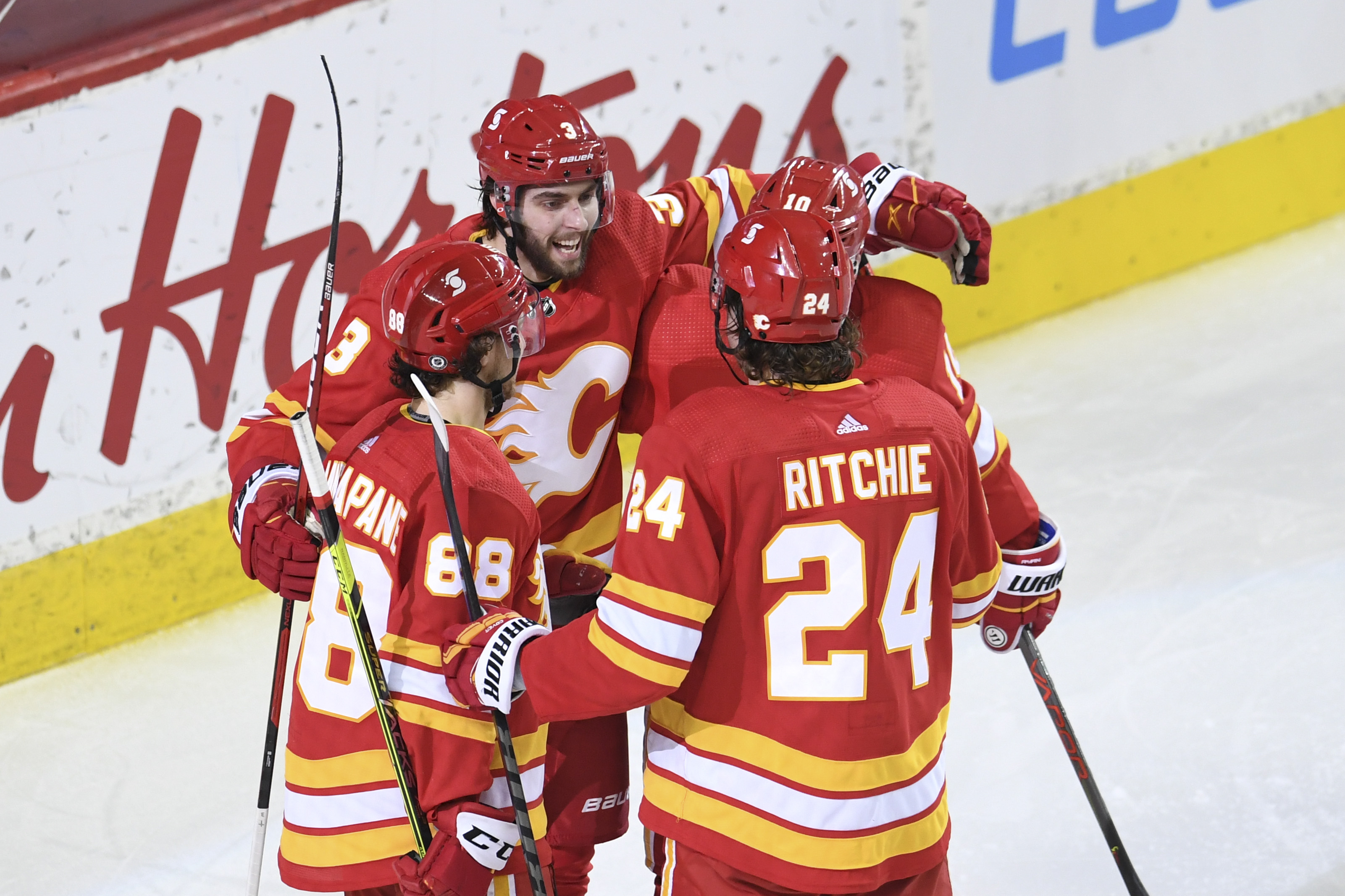 Calgary, Alberta, CAN; Calgary Flames defenseman Connor Mackey (3) celebrates his third period goal against the Vancouver Canucks at Scotiabank Saddledome. Flames won 6-2.