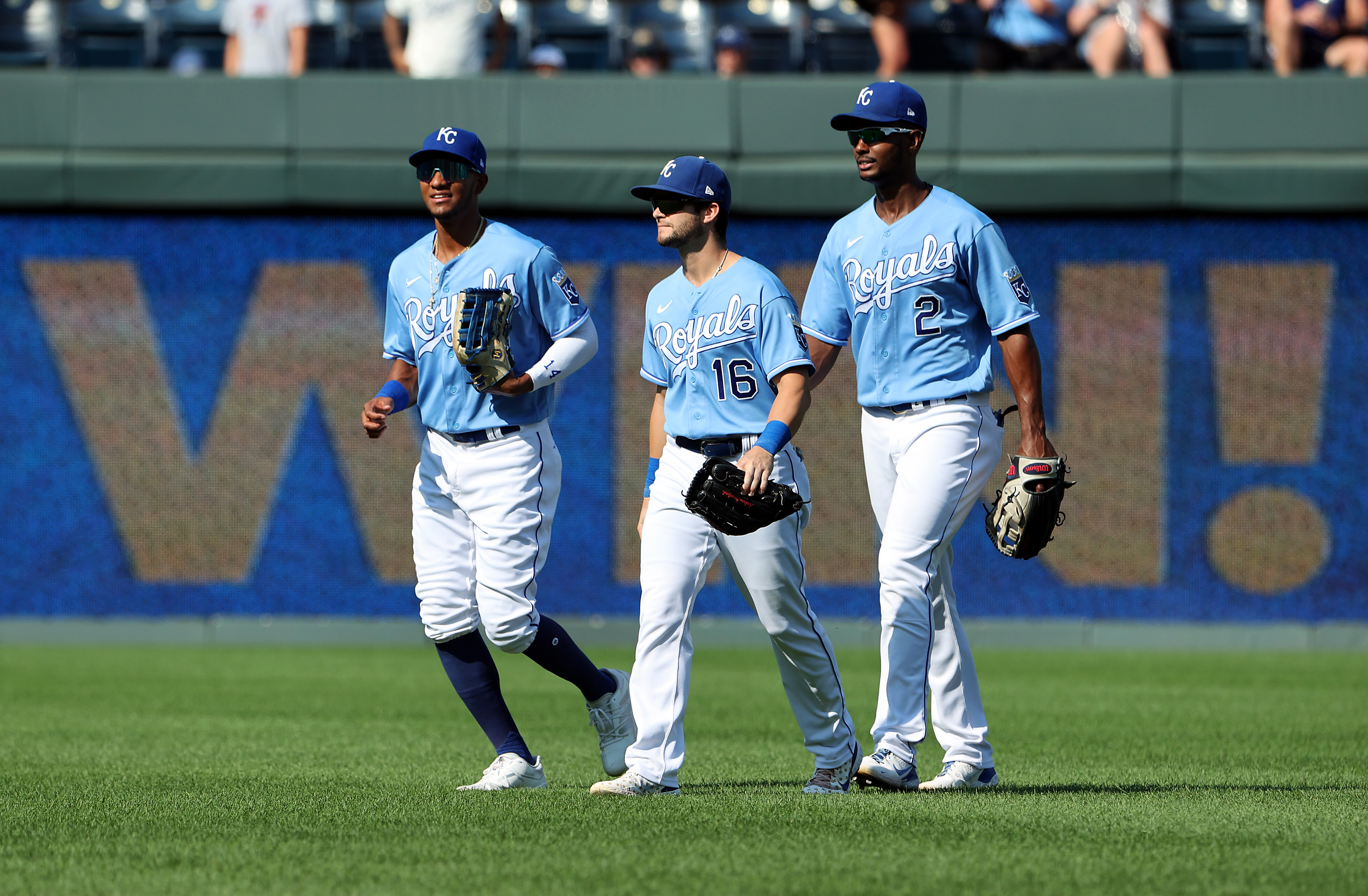 Outfielders Edward Olivares #14, Andrew Benintendi #16 and Michael A. Taylor #2 of the Kansas City Royals congratulate each other after the Royals defeated the Chicago White Sox 6-0 to win the game at Kauffman Stadium on September 05, 2021 in Kansas City, Missouri.