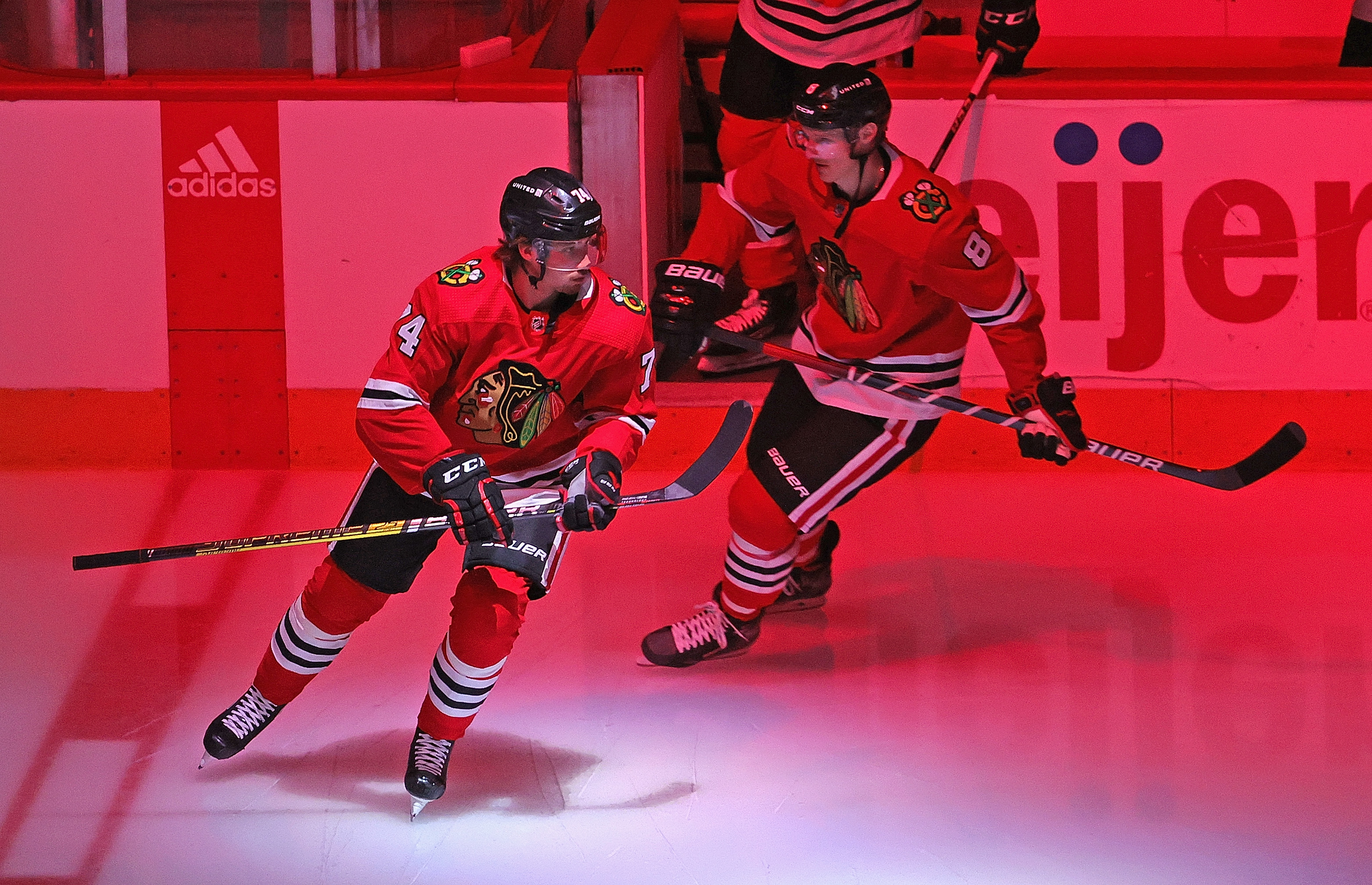 Nicolas Beaudin #74 and Dominik Kubalik #8 of the Chicago Blackhawks skate onto the ice before a game against the Dallas Stars at the United Center on May 10, 2021 in Chicago, Illinois.