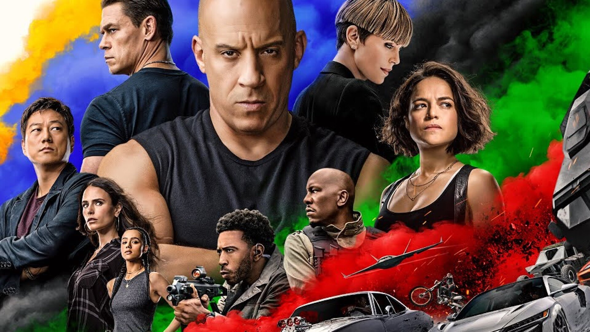An F9 promo image, with Vin Diesel and the rest of the cast against a background of brightly colored smoke
