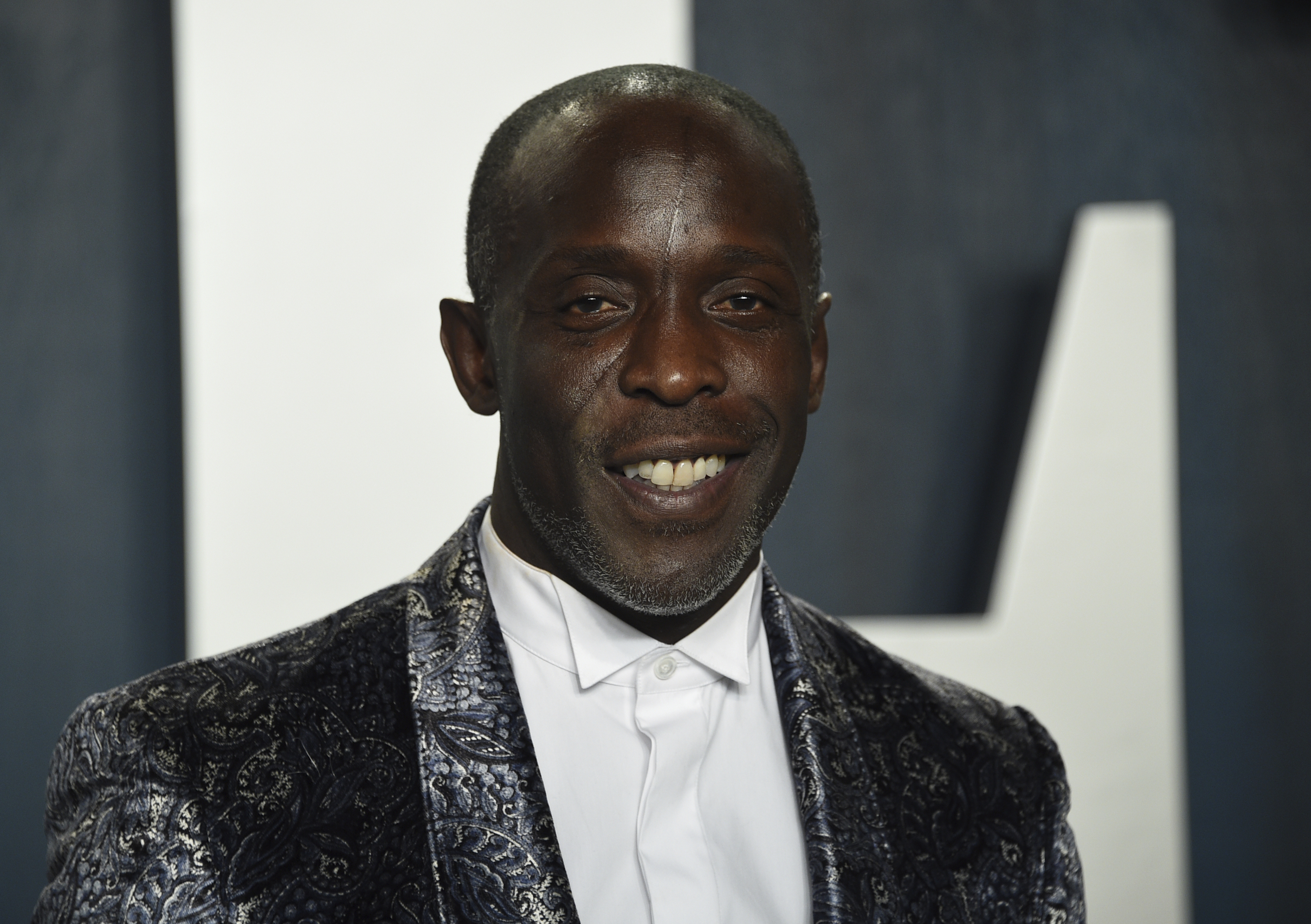 """In this Sunday, Feb. 9, 2020, file photo, Michael K. Williams arrives at the Vanity Fair Oscar Party in Beverly Hills, Calif. Williams, who played the beloved character Omar Little on """"The Wire,"""" has died. New York City police say Williams was found dead Monday, Sept. 6, 2021, at his apartment in Brooklyn. He was 54."""